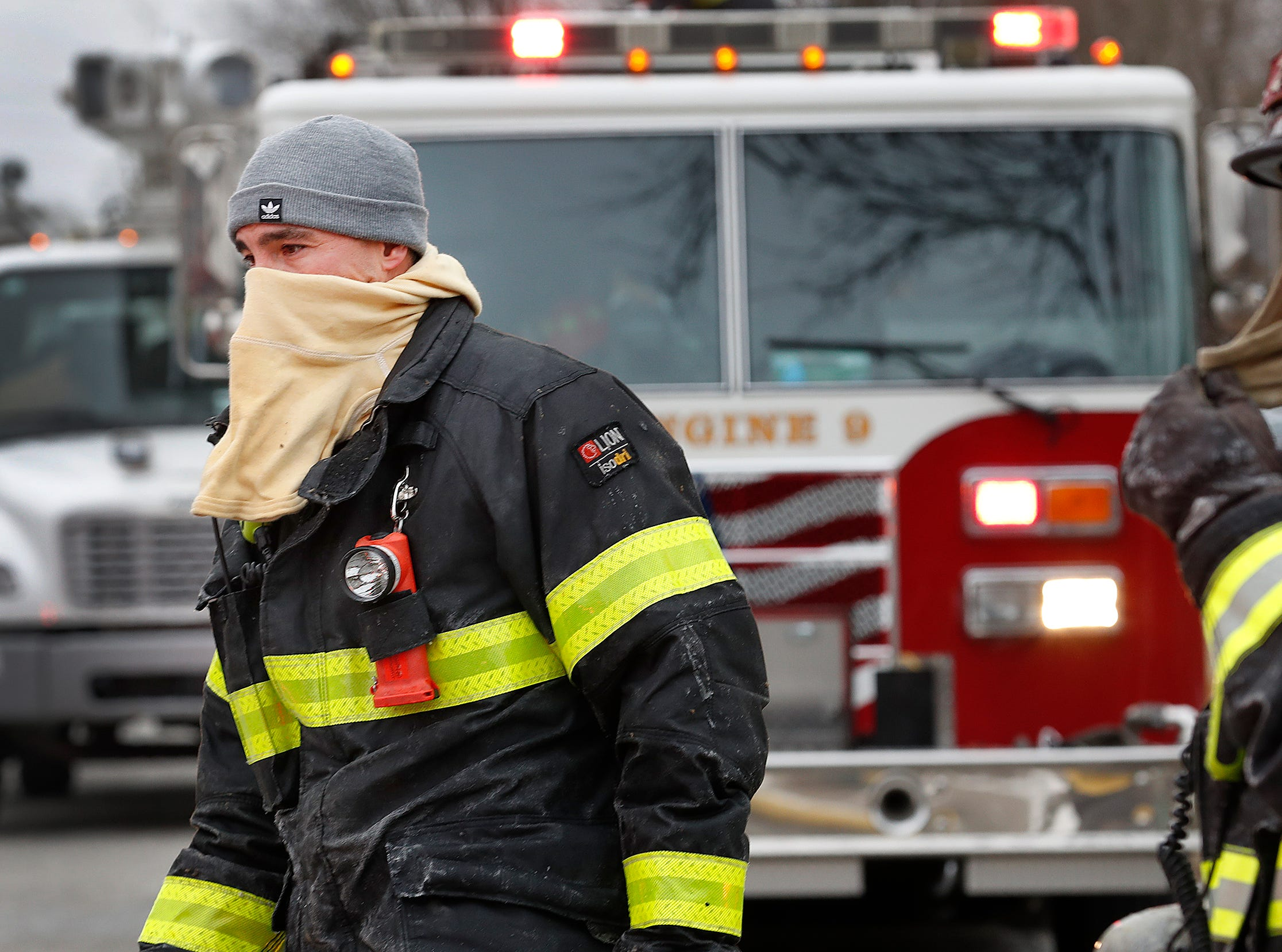 Fire fighters from Indianapolis and Fishers battled a house fire at the corner of Castle Farms Rd. and Prairie Drive and then attempt to stay warm on Thursday, Jan. 30, 2019. No one was injured in the single home fire on the far Northeast side of Indianapolis.