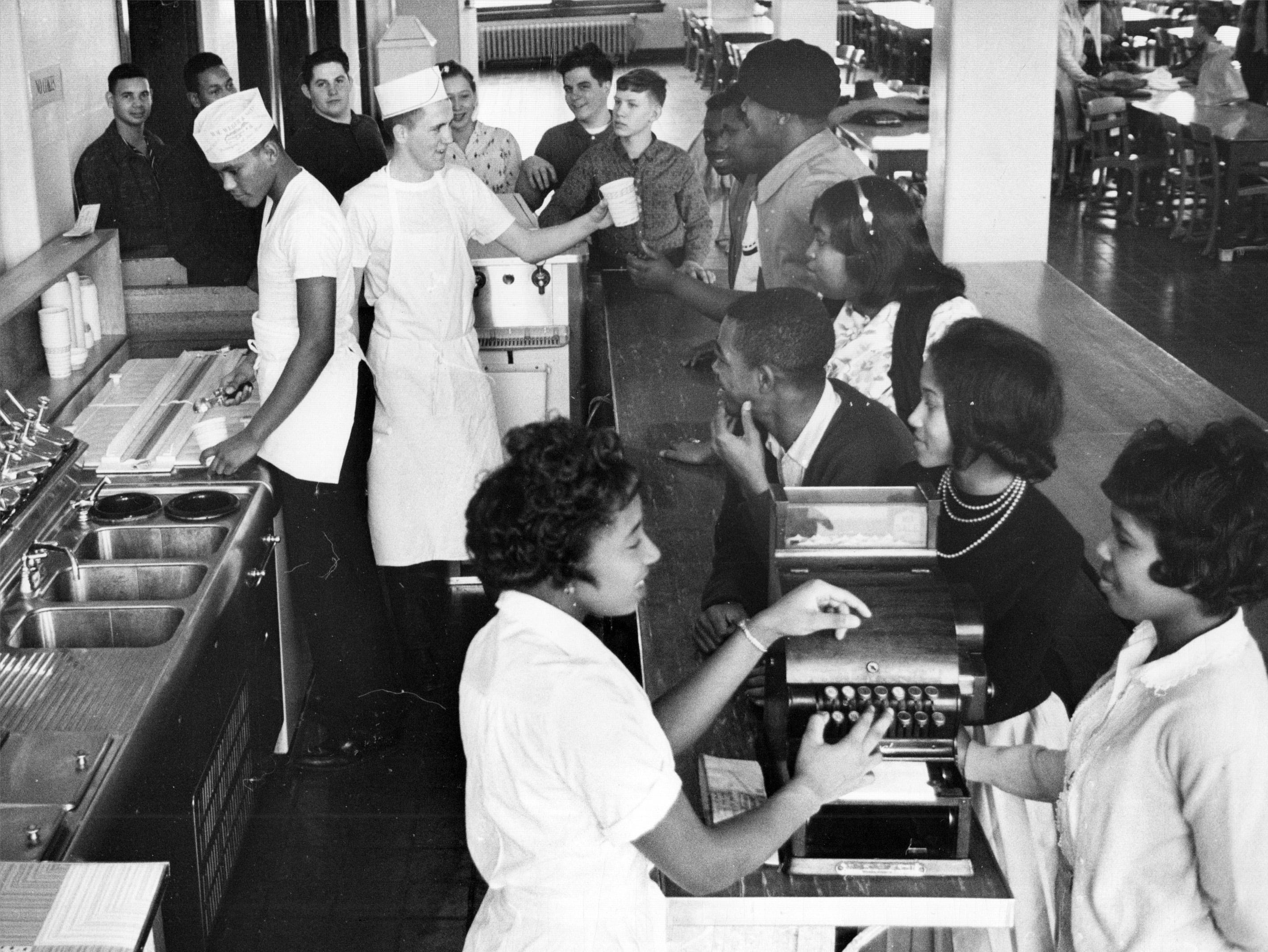Wood high School students crowd a new ice cream bar - the first of its kind in Indianapolis high schools - in the school cafeteria in 1962.