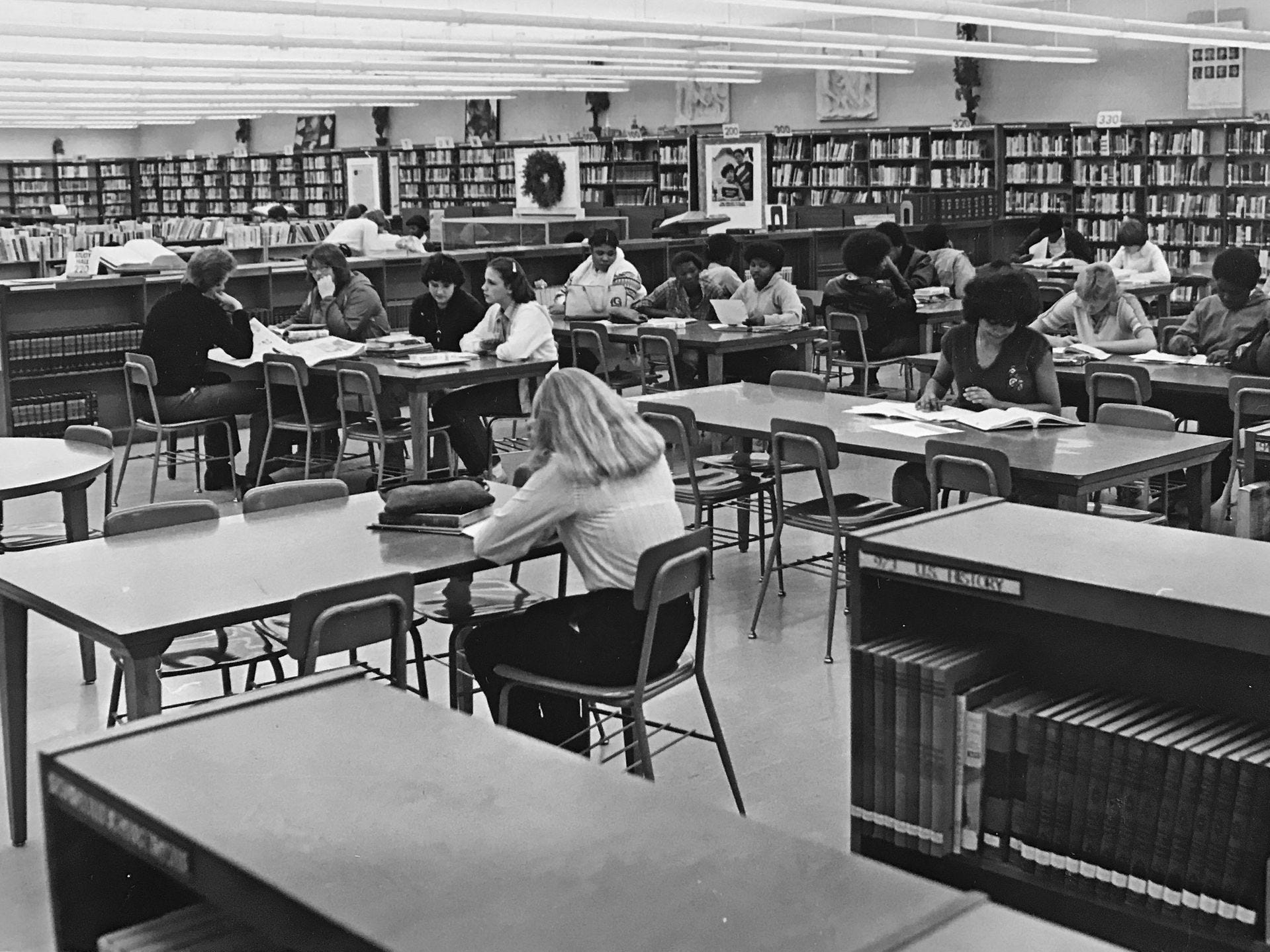 Students in the Northwest High School library in 1981.
