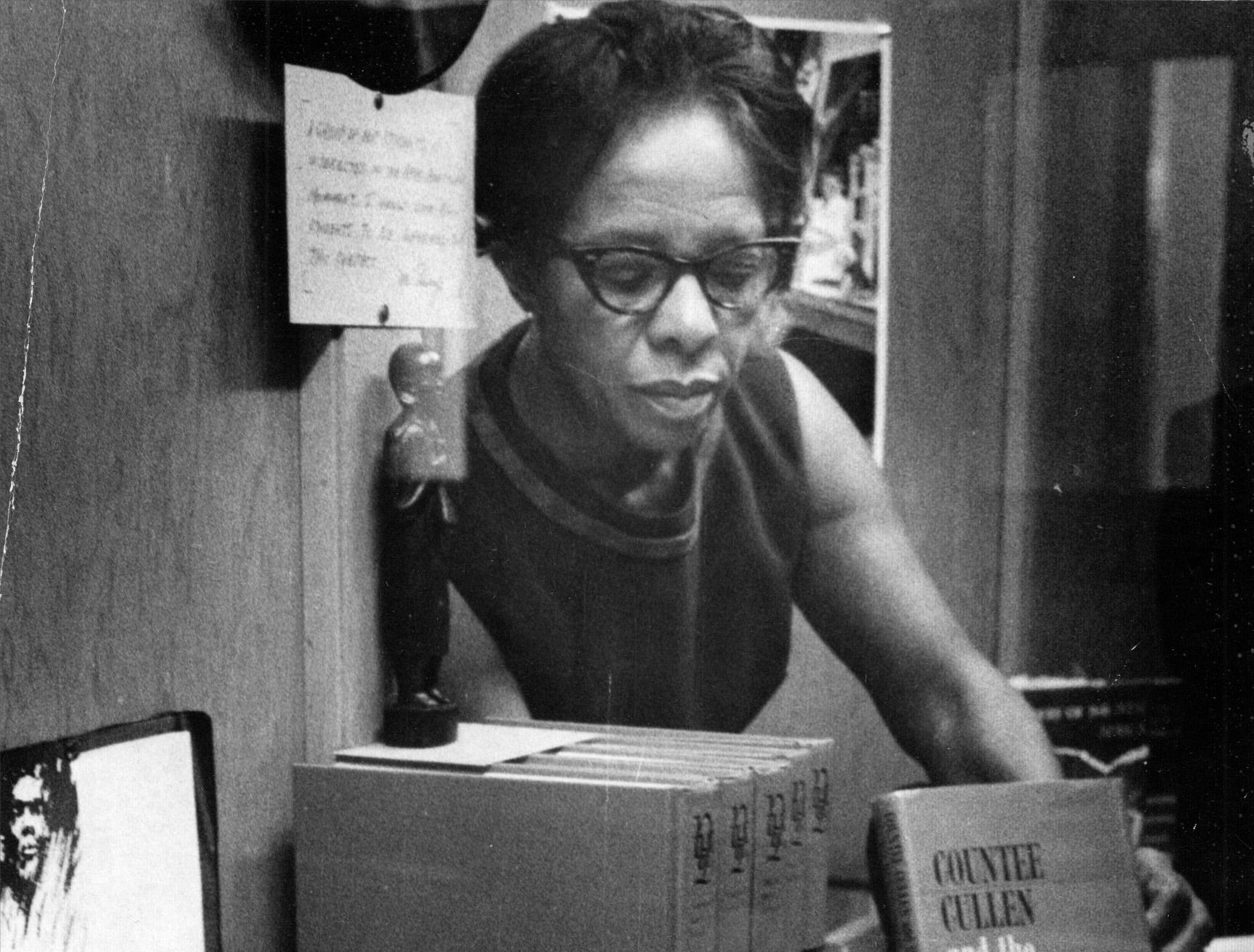 "Harry Wood teacher Jacque Ferguson, works on a display on African-American history at the school in 1968. Ferguson wrote ""Countee Cullen and the Negro Renaissance"" which she places in the display"