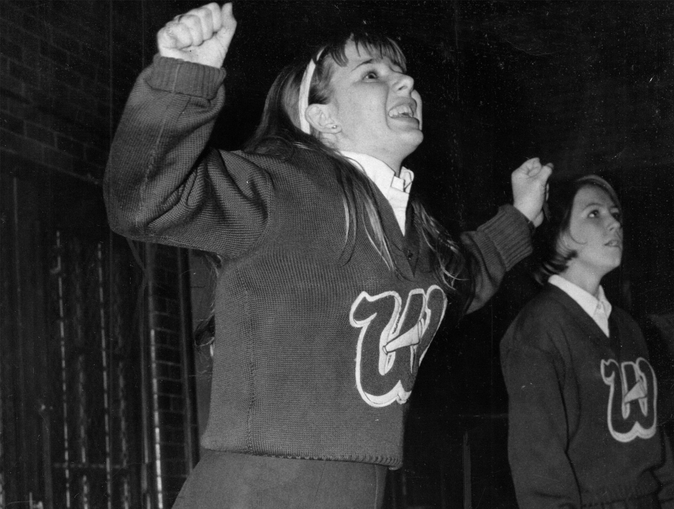 Despite the encouragement of Wood cheerleader Irene Schelske, the Woodchucks lost to Shortridge 95-71 in December, 1967.