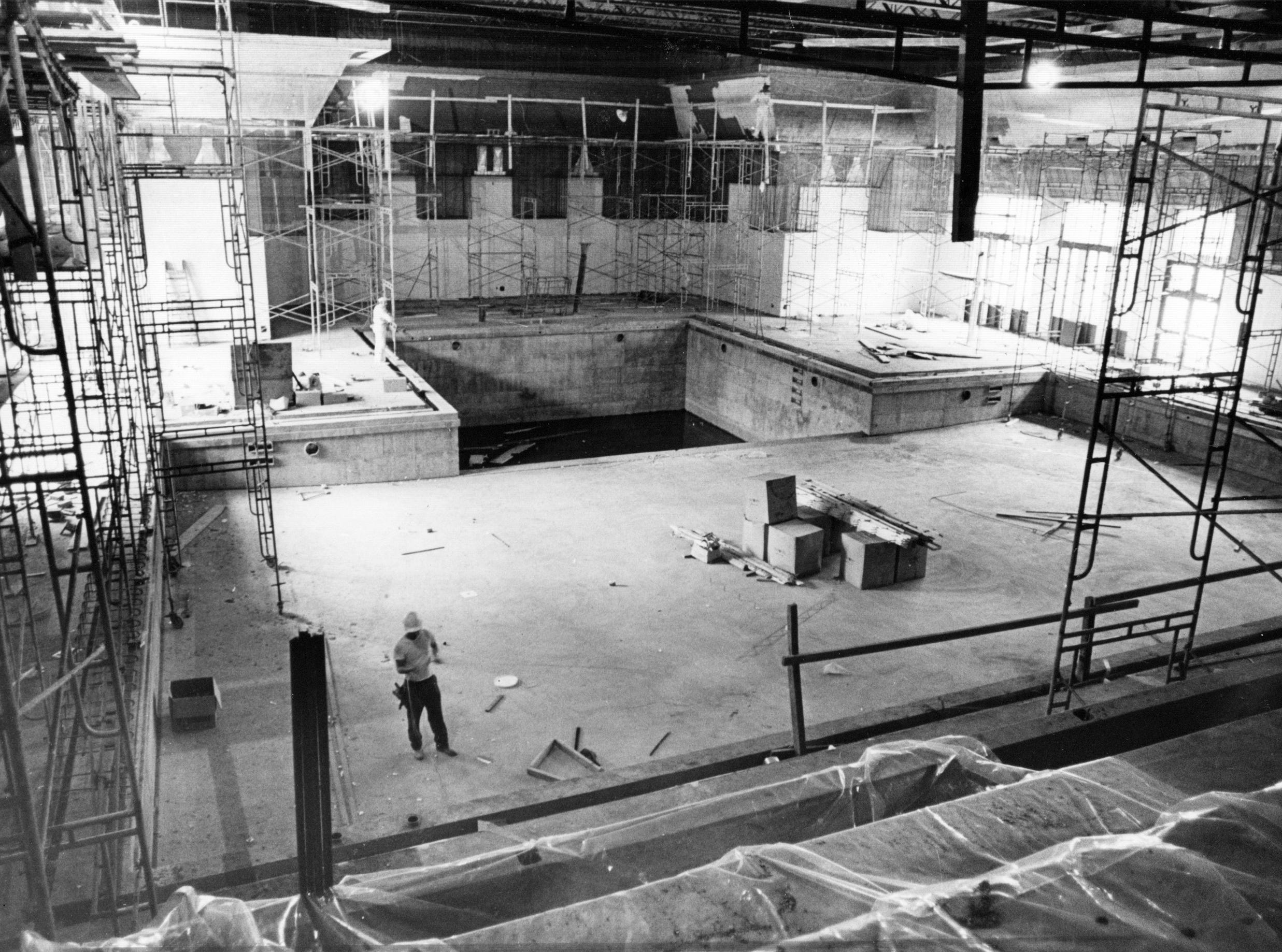 Workers in the swimming pool in the girls gymnasium at Arsenal Tech High School in 1976.
