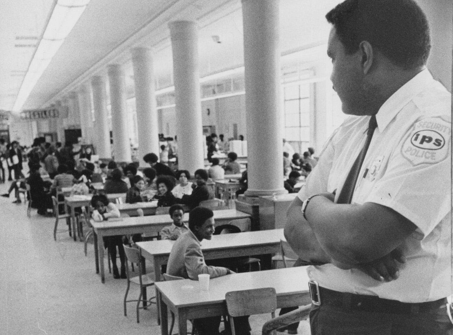 A Shortridge guard monitors the cafeteria in 1973.