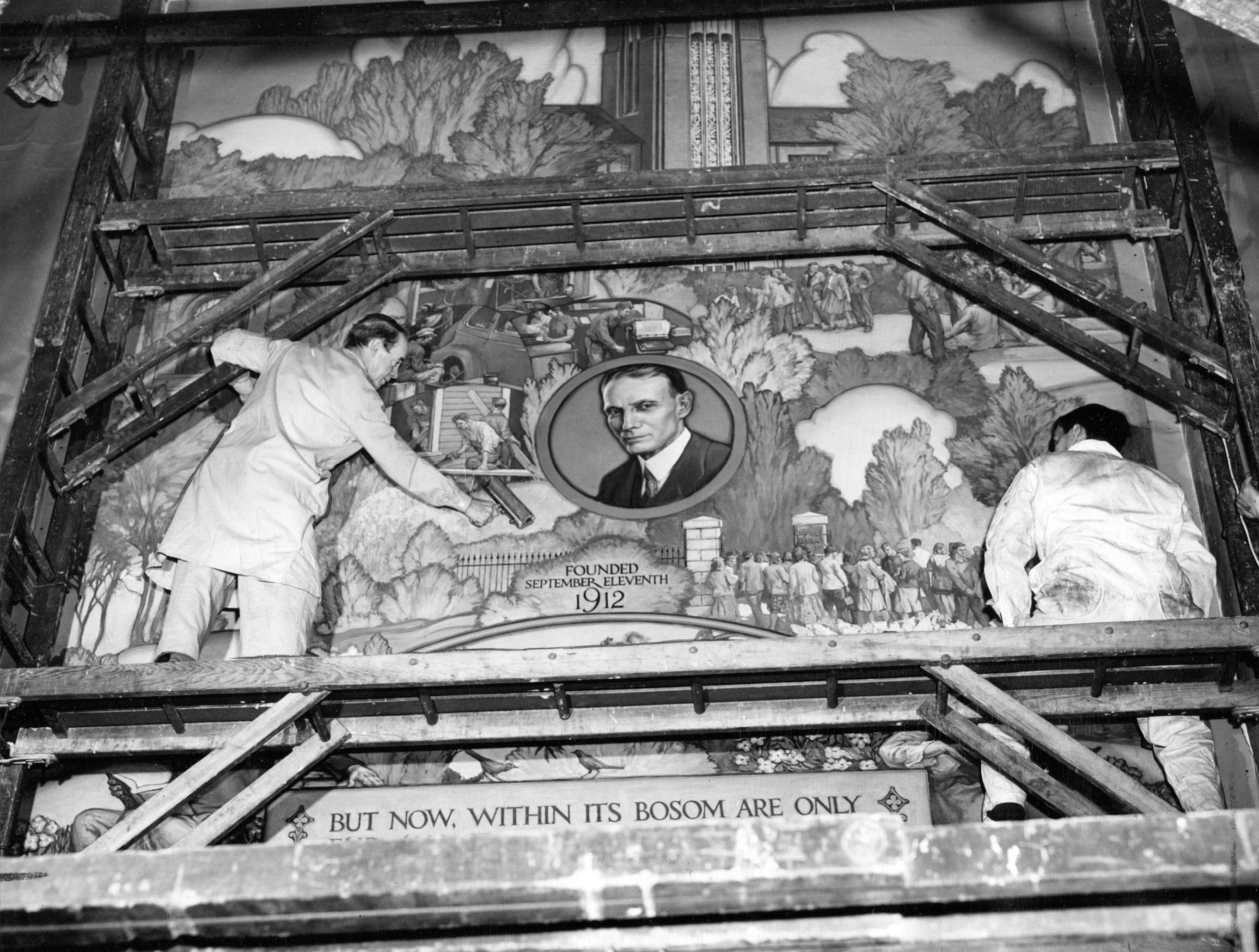 Murals for the Stuart Memorial Tower at Arsenal Technical High School are smoothed onto the walls by the artist, J. Scott Williams in 1948. The central portrait is of Milo Stuart, first principal of Tech, who served more than 20 years as head of the school.