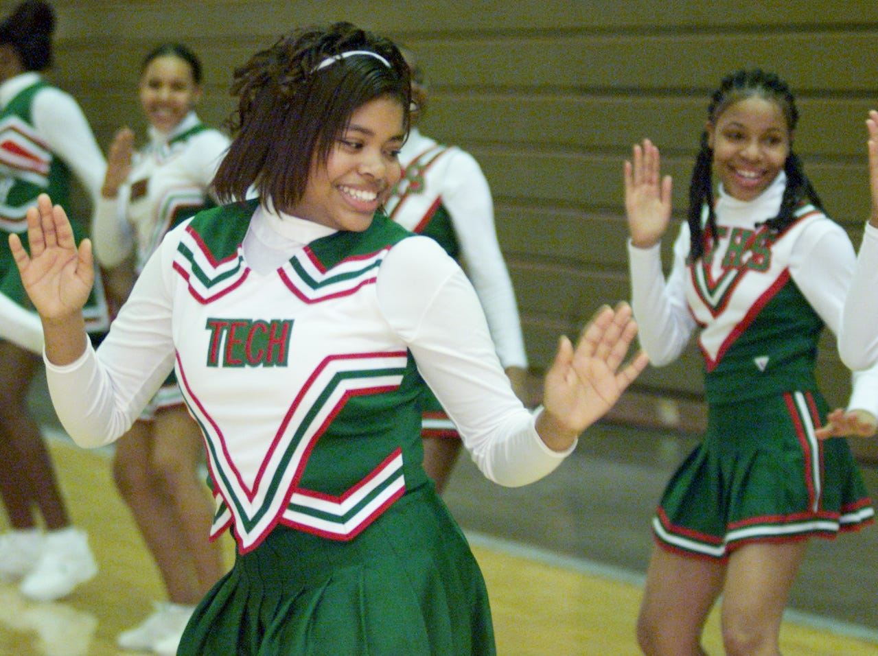 Sharonda Hadnott, 14, center foreground, of Arsenal Technical High School leads her fellow Titan cheerleaders in a routine during the PeyBack Classic II at the school's West gymnasium on Tuesday, December 11, 2001.