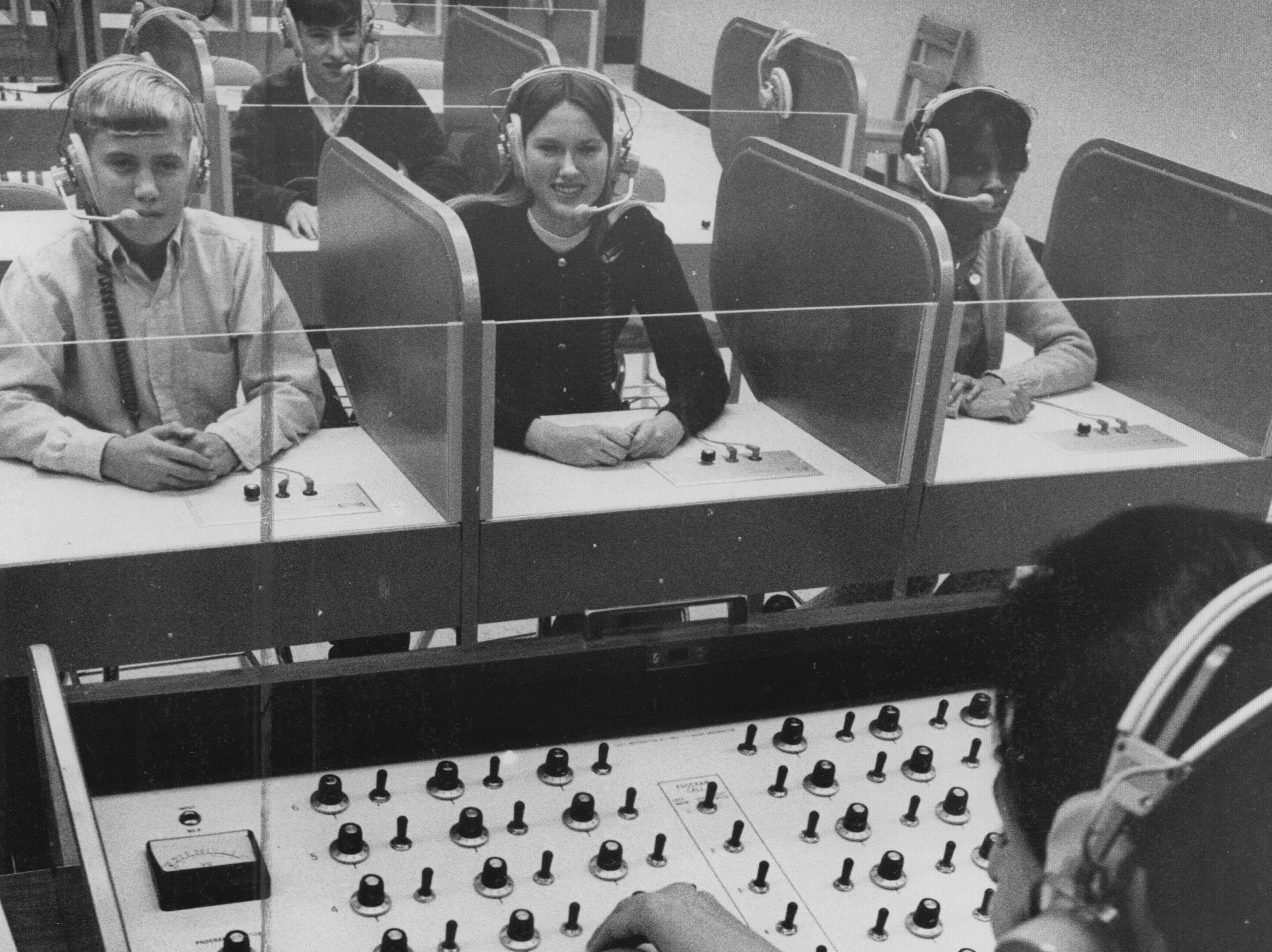 John Marshall teacher Sylvia Ketterman sits at the control center in the language laboratory in 1967.