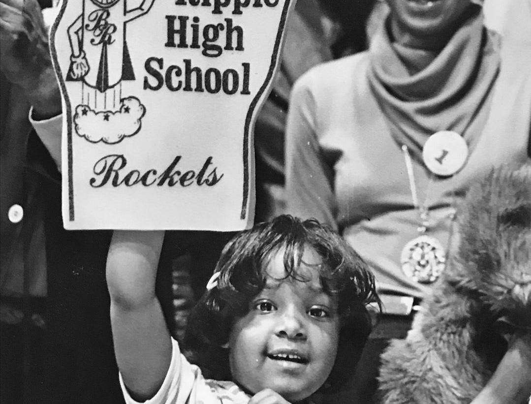 Young Broad Ripple High School fan Latasha Radford, show's who's No. 1 after the Rockets beat Shelbyville 64-45 to win the Hinkle Semistate title in 1980