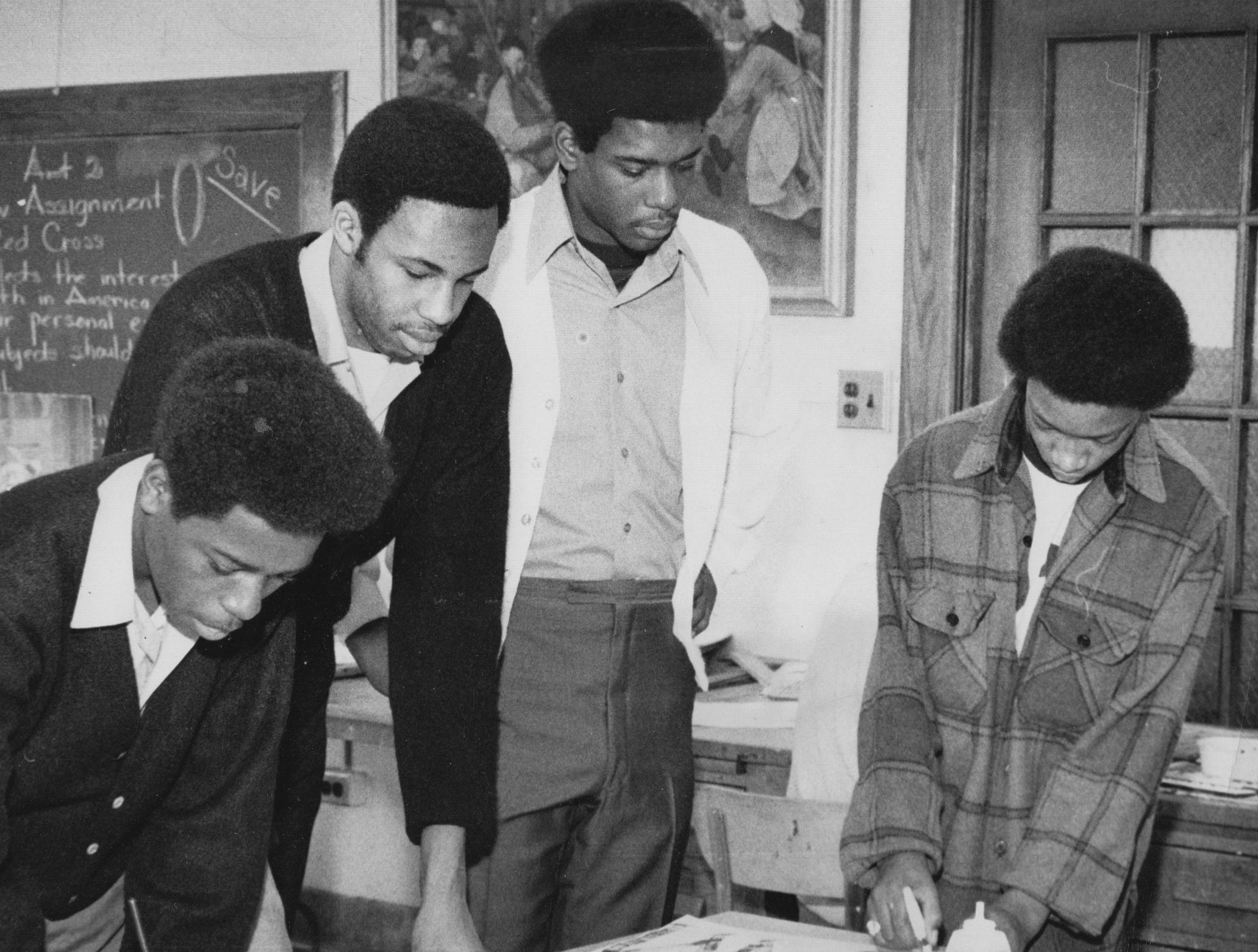 Art students at Crispus Attucks work on posters to support te basketball team as they go into semistate competition in 1970.