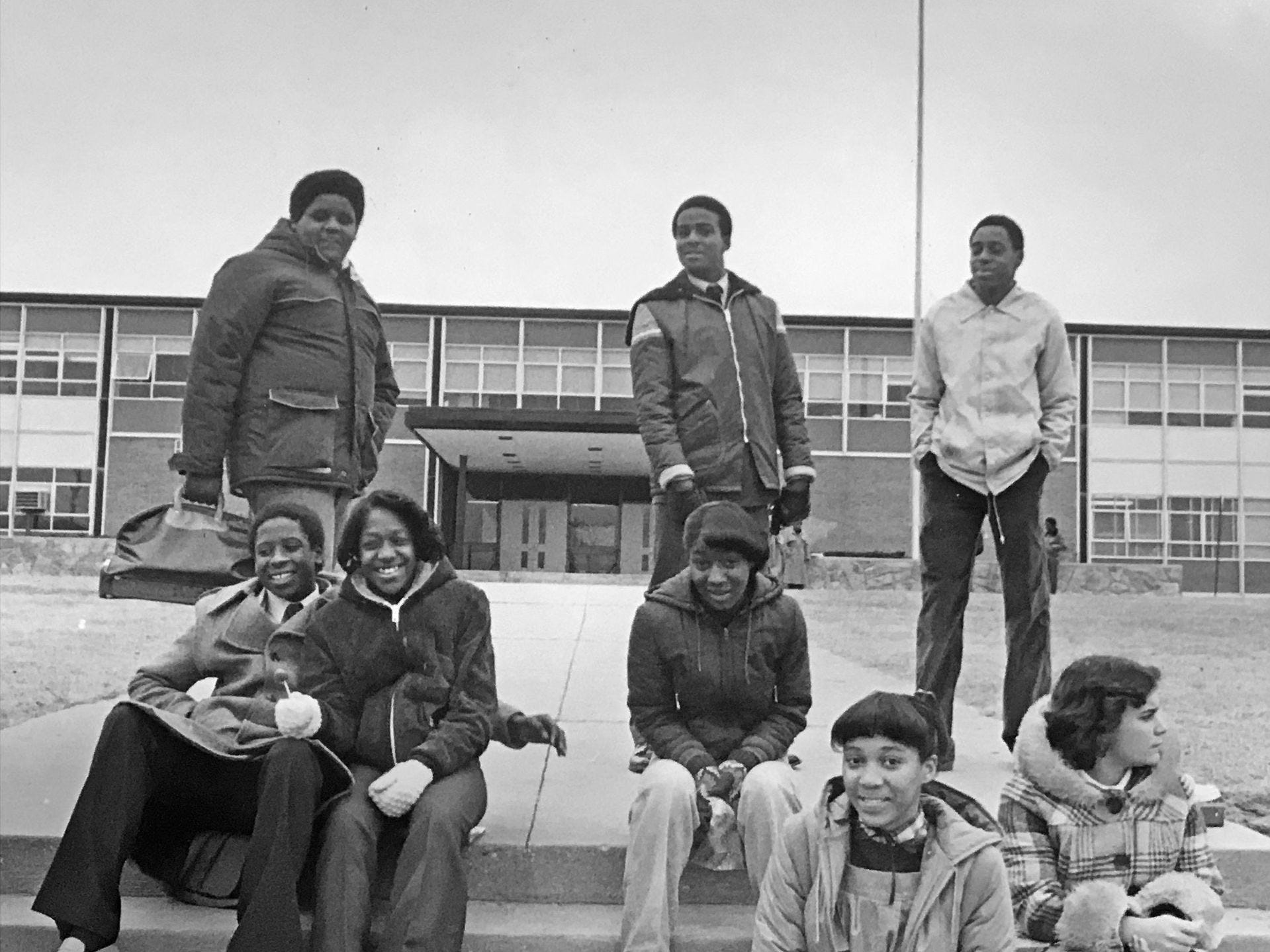 Students wait for the bus outside Arlington High School in 1980.