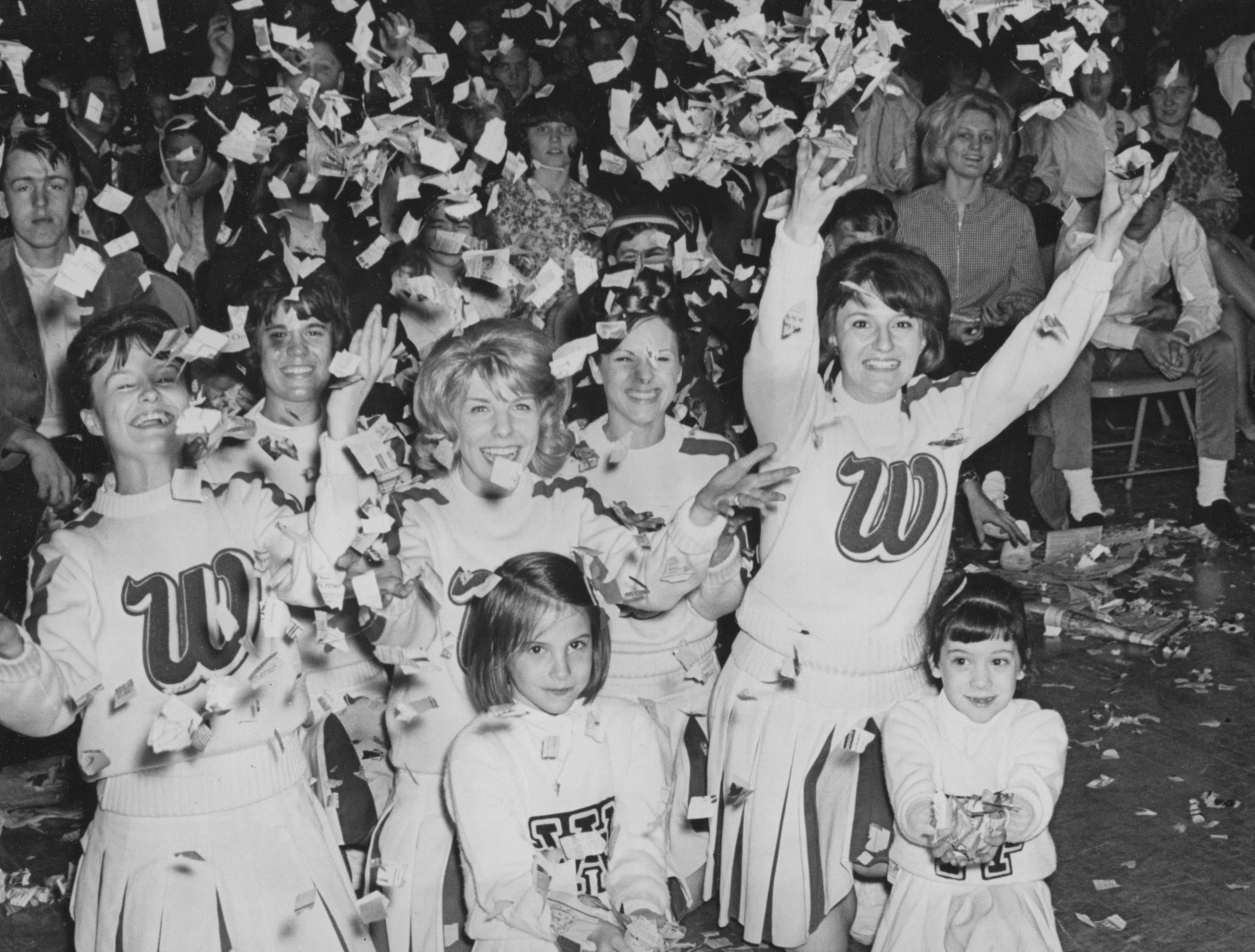 Cheerleaders celebrate and let the confetti fly at the Washington High School gym after the Continentals won their first Indianapolis semi-state basketball title in 1965. 