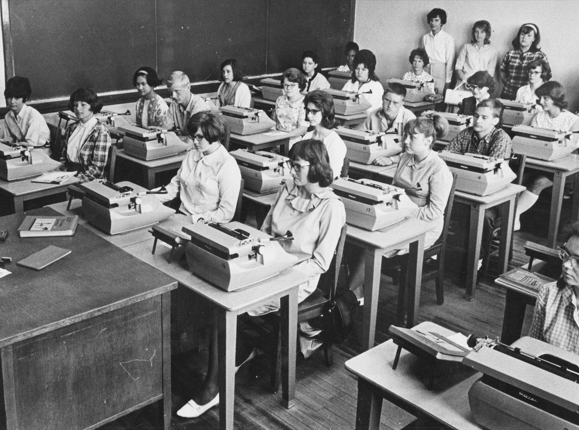 "Washington High School students take a typewriting class with teacher Paul Carmichael during summer school in 1965. Some of you might remember this class was also called ""keyboarding""."
