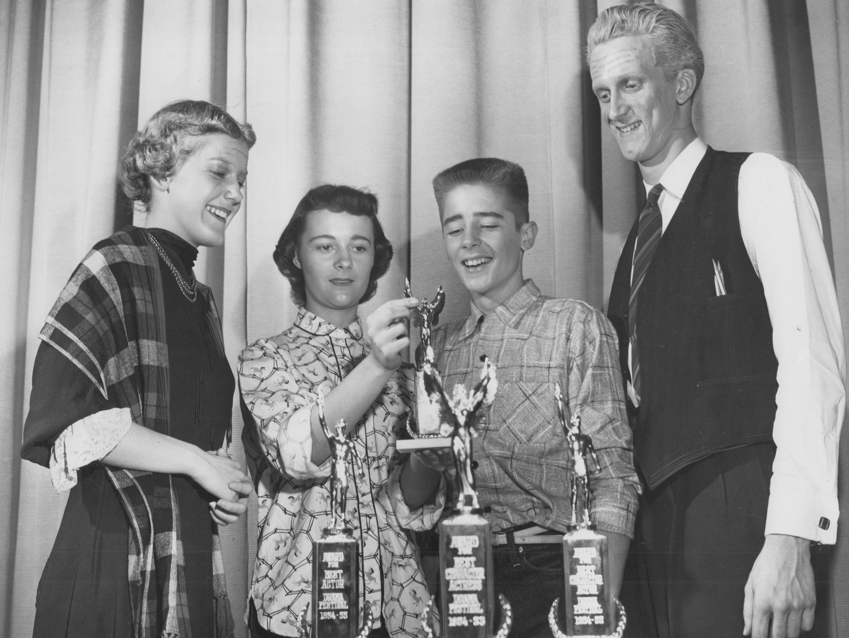 Broad Ripple and Thomas Carr Howe High School thespians won all the individual acting awards during the 1954 Indianapolis High School Drama Festival at Emmerich Manual Training High School. Comparing trophies are (left to right) Barbara Miles, Broad Ripple; Best character actress, Susan Stirling, Howe; best straight actress; James Harvey, Howe, Best straight actor and Robert Wait Broad Ripple, best character actor.