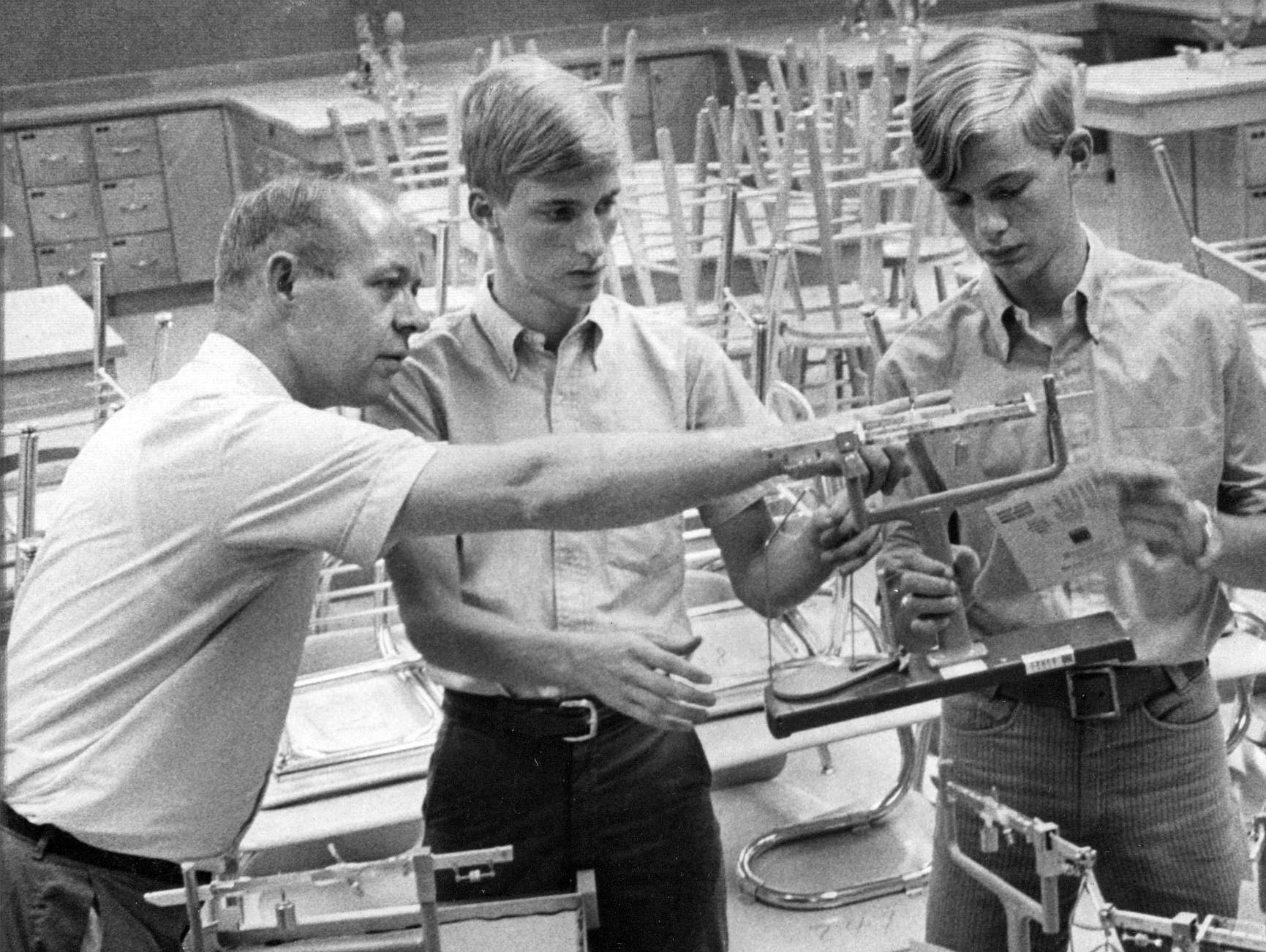 Robert Weaver (left) head of the science department and John Marshall High School and Jay and Ray Johnson examine lab equipment for the new school in 1967.