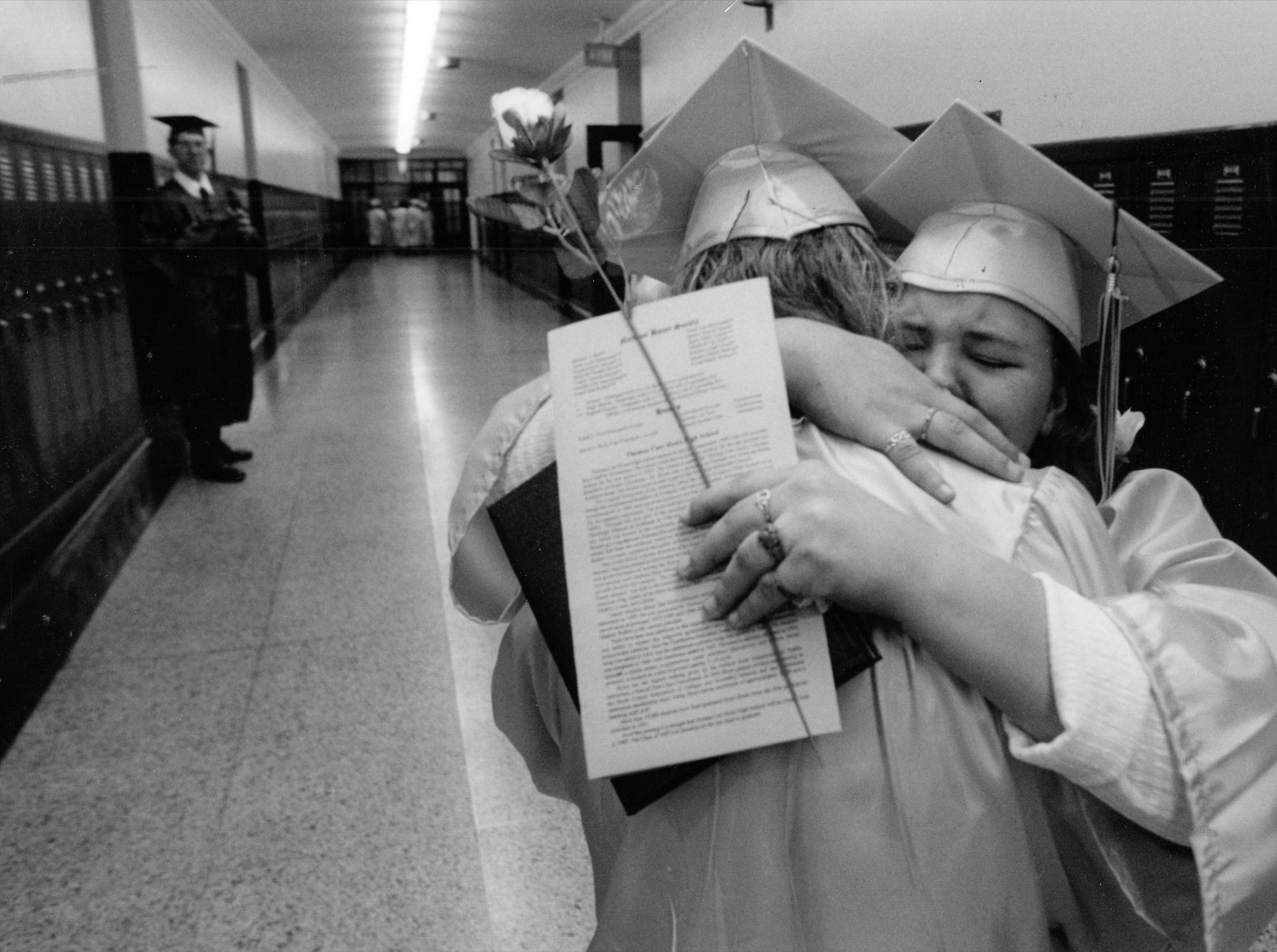 Howe graduates Rebecca Hicks and Jamie Bohannon share a hug after the final graduation ceremony in 1995.