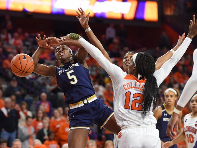 Notre Dame's Jackie Young is fouled by Clemson's Aliyah Collier during the first half of an NCAA college basketball game Thursday, Jan. 31, 2019, in Clemson, S.C.