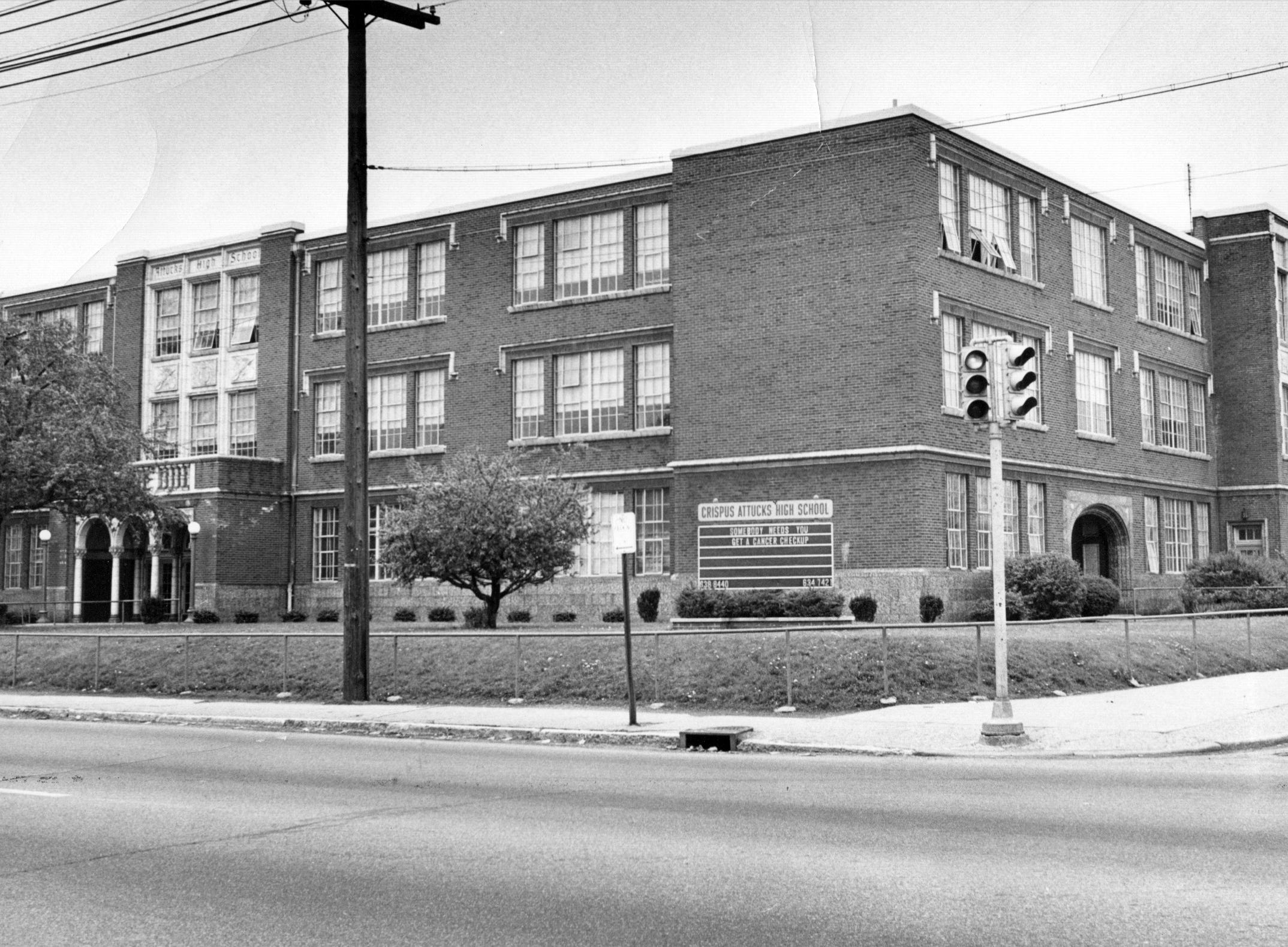Attucks High School in 1971. Created in the 1920s by a Ku Klux Klan-dominated school board, the school remained specifically for black students who lived throughout Indianapolis until 1949 when the school system adopted a desegregation police and instituted a neighborhood school system.