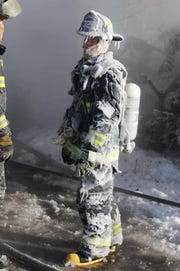 Dramatic photos posted to social media show the Hammond Fire Department battling flamesand bitter cold atahouse fire that claimed the life of a woman Wednesday.