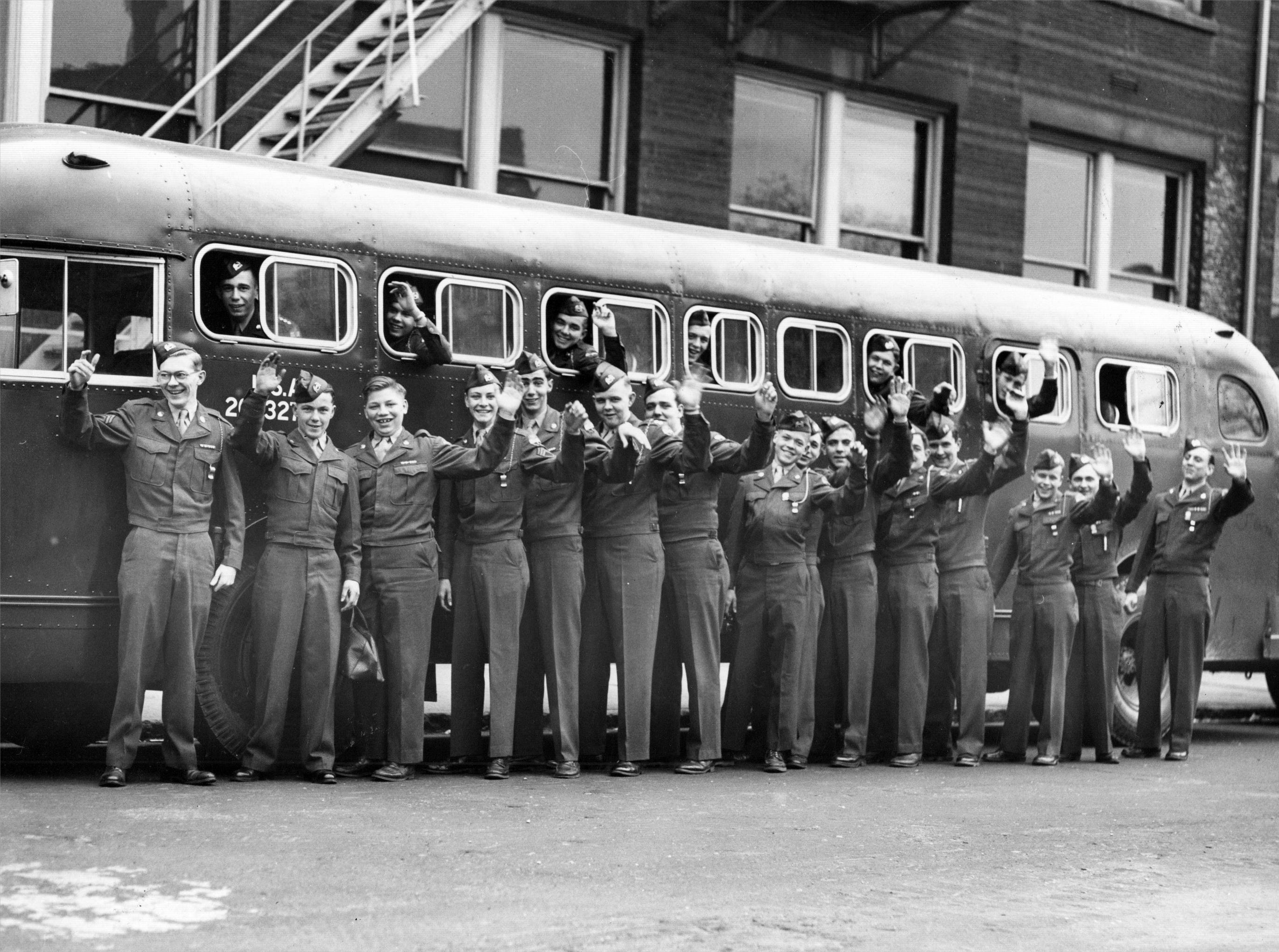 Manual High School ROTC boys get ready to board a bus for Camp Atterbury training in 1953.