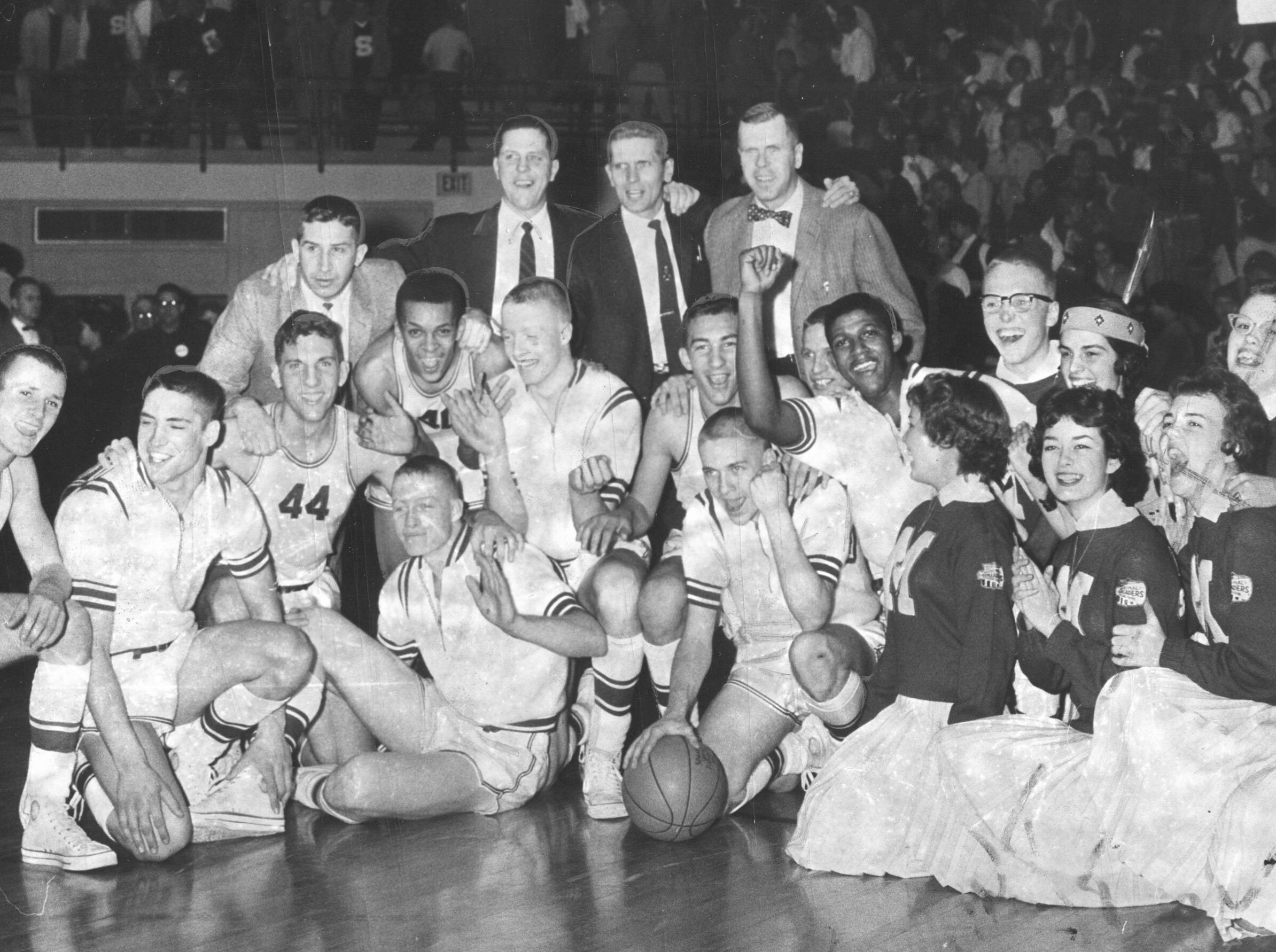 Manual, 1960. The Redskins celebrate after their 71-61 Southport Sectional victory over Southport Feb. 27, 1960. In the back row are coaches, Woody McBride, Head coach Dick Cummins, Paul Roberts and Harold Bennett. Players ini the front row are left to right - Ed Stiegelmeyer, Larry Short, Dick Foran #44, Leon Carter, #40, Dick Van Arsdale, Tom Van Arsdale, Dave Scheib, Jim Cummings, Armen Cobb and Roger Wood.  This was Manual's first sectional victory in 37 years.
