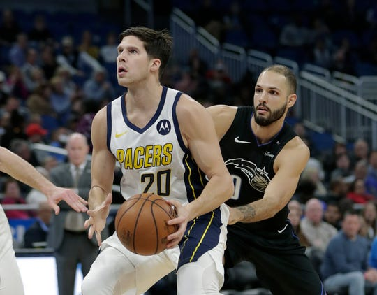 Indiana Pacers' Doug McDermott (20) looks to shoot as he gets past Orlando Magic's Evan Fournier, right, during the first half of an NBA basketball game, Thursday, Jan. 31, 2019, in Orlando, Fla.