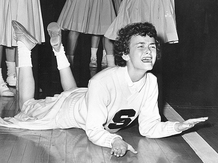 Mon. 11/15 Flashback                                                                              Sharon Bruce, a cheerleader for Shortridge High School, pounded the hardwood after the Blue Devils lost a heartbreaker to Tech High School in the final seconds of their sectional matchup at Butler Fieldhouse in 1961. Shortridge was headed to victory over Tech when the Greenclads scored the winning basket with 7 seconds remaining. The photo was picked up by The Associated Press and ran in newspapers all around the world. Sharon knows this from the bags of mail and clippings she received, including many from soldiers who saw the photo in Stars and Stripes. She graduated from Shortridge in June 1961. Twenty years later, Shortridge was converted into a juniorhigh school. Today, Sharon is married to Marion County Superior Court 13 Judge Steve Frank and has two daughters, Whitney and Courtney, and a step-daughter, Lisa Frank. Whitney and Coutney played girls volleyball at Cathedral High School. Whitney received afull volleyball sports scholarship to Notre Dame in the late Ô80s. Sharon worked for a time as a legal secretary, during which time she met her husband, Steve. Tech's nickname became the Titans in 1962. Photo by Indianapolis News photographer Joe Young, Feb. 22, 1961