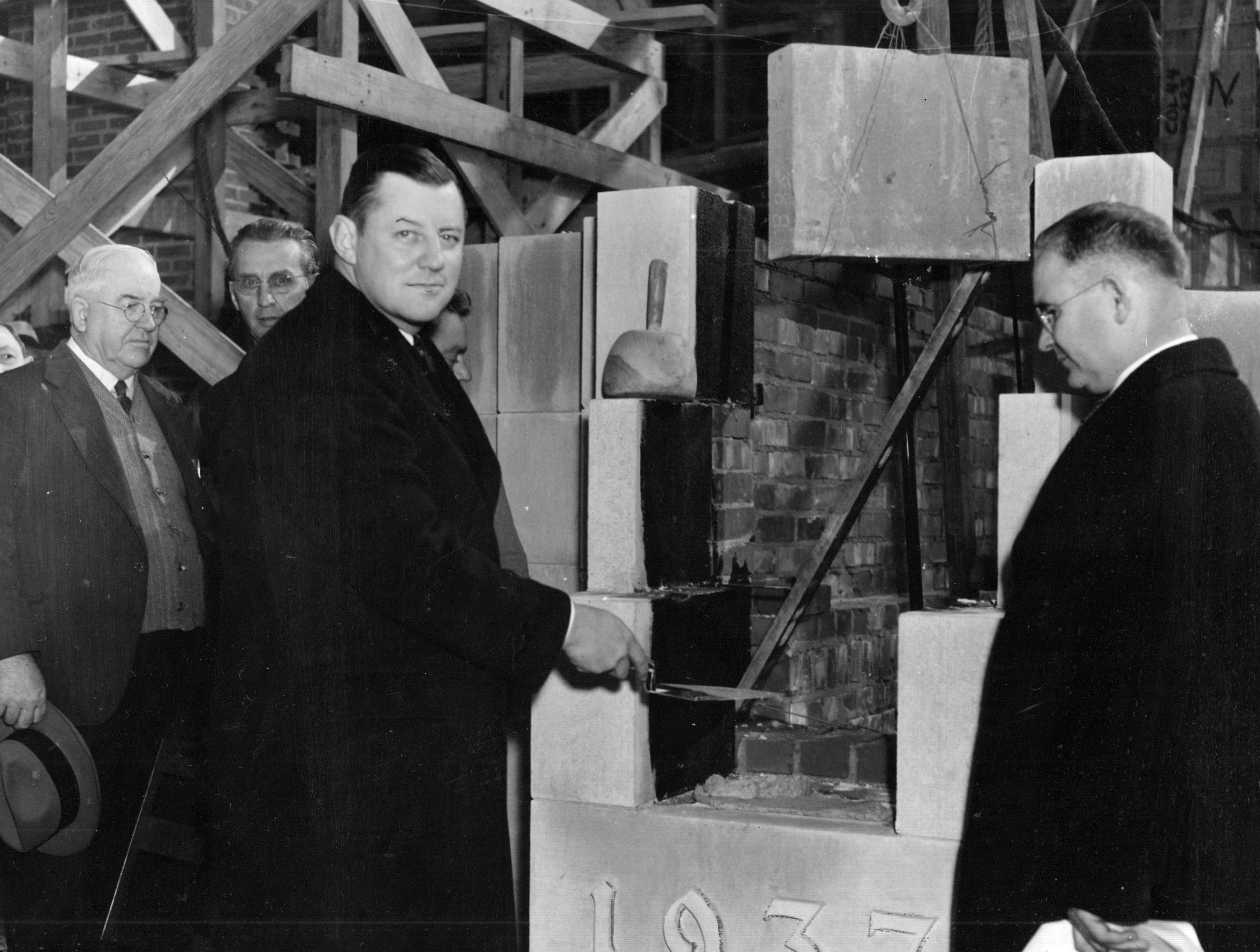 Alan W. Boyd (with trowel), president of the Board fof School commissioners, laying the cornerstone of the Thomas C. Howe High School on Nov. 11, 1937 with DeWitt Morgan, superintendent of schools.