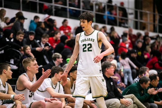 Iowa City West's Patrick McCaffery (22) high-fives teammate Even Brauns (34) while heading to the bench during a Class 4A boys' basketball game on Thursday, Jan. 31, 2019, at West High School in Iowa City, Iowa.