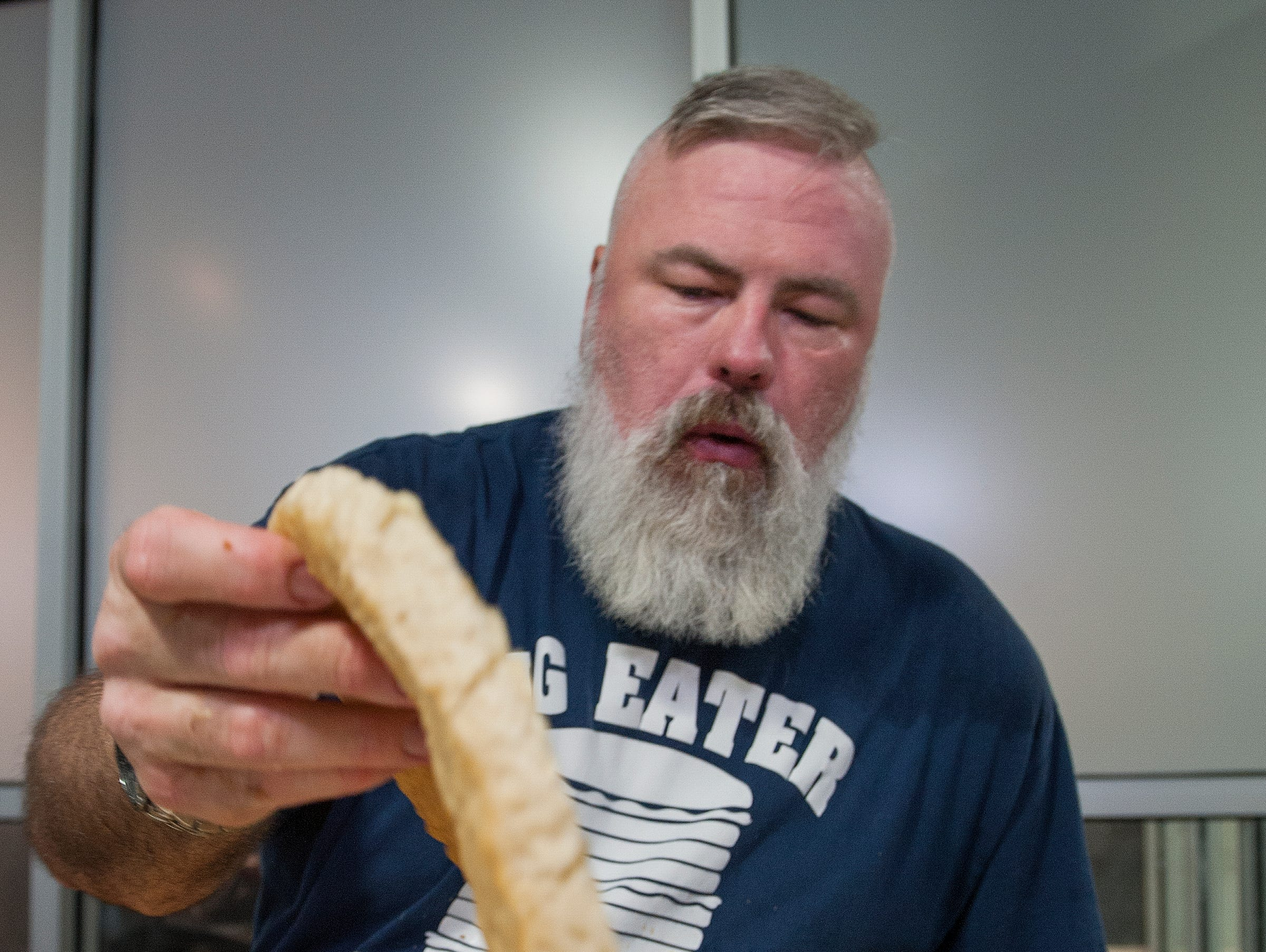 Nothing but the bottom of the 10-inch hamburger bun remains to be eaten for Mike Whities of Brandon, also known as Big Eater Mike, to win the Rooster's Stupid Burger Challenge at the Fondren restaurant on Friday, Feb. 2, 2019. Big Eater Mike went on to win the challenge, eating 6 pounds, 8 ounces of burger and fries within 30 minutes.