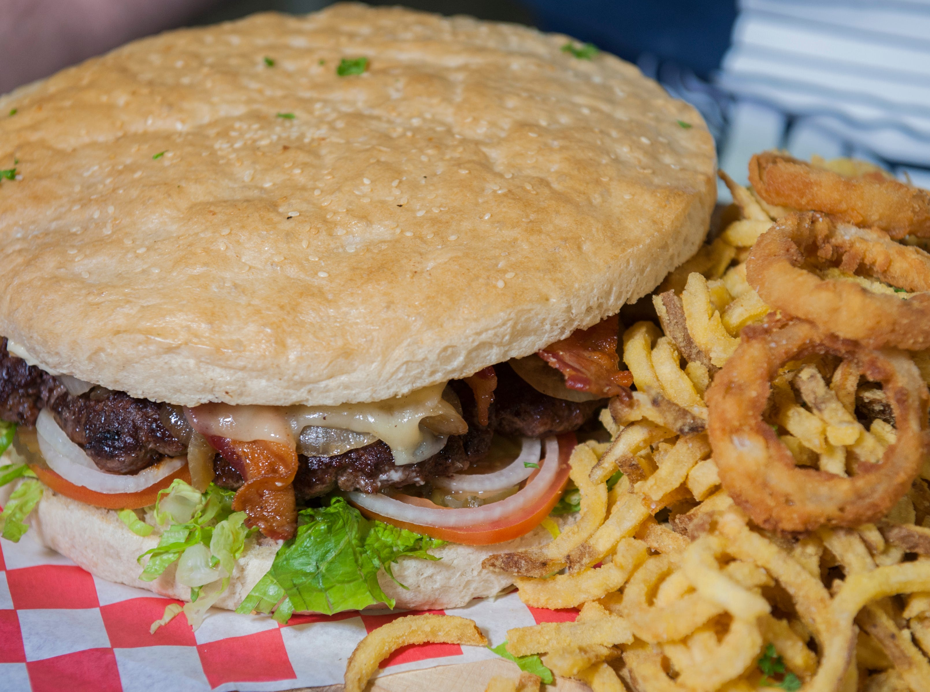 Big Eater Mike of Brandon won Rooster's first Stupid Burger Challenge. Are you up for the challenge? Check it out at the Fondren restaurant in Jackson, Miss.