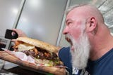 Was wolfing down the 'Stupid Burger' smart? Brandon's 'Big Eater Mike' chews the challenge to bits