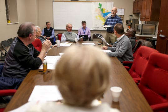 Council members listen to Stan Pilot explain notes from the agenda during a city council meeting at Jackson City Hall in Jackson, Tenn., on Thursday, Jan. 31, 2019.