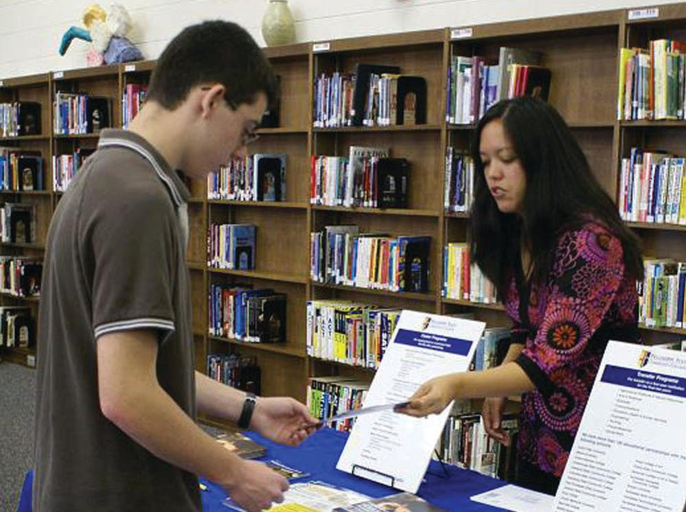 reader-submitted photoTwelve area colleges came to Carter High School to meet prospective students. Senior Adam Lyons, left, talks to Priscilla Gitschlag from Pellissippi State Community College about possibilities for him at that school.