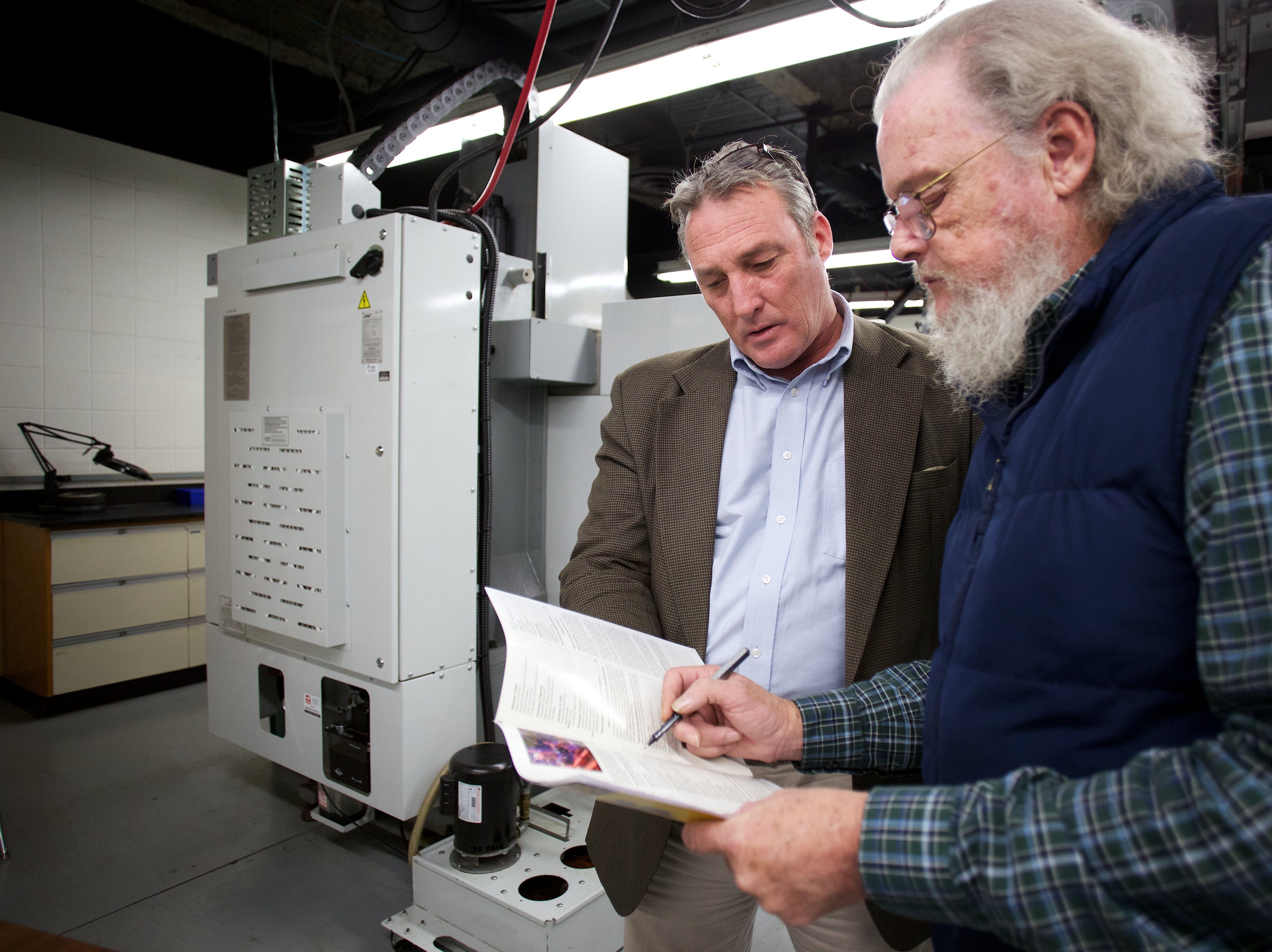 PSCC professor, Pat Riddle, right, shows Pellissippi's Director of Solutions Management, Rick Heath classes that Heath's involvement is needed during a CNC Milling class at PSCC's Hardin Valley Campus on Thursday, November 7, 2013. Heath works in the Business and Community Services department for Pellissippi State Community College.