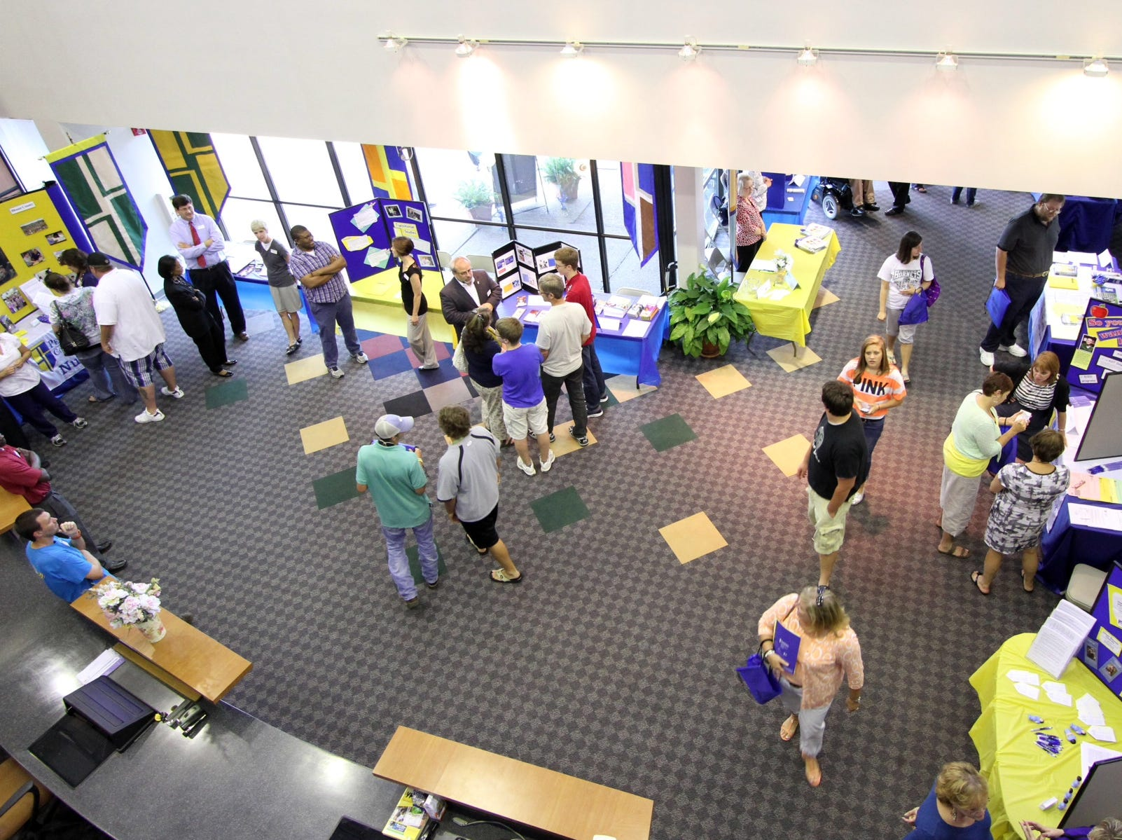 Visitors crowd the lobby during an open house Tuesday, May 15, 2012 at Pellissippi State Community College's new Strawberry Plains campus. Prospective students got a first look at the facility and learned about the school's dual enrollment, financial aid and academic programs.