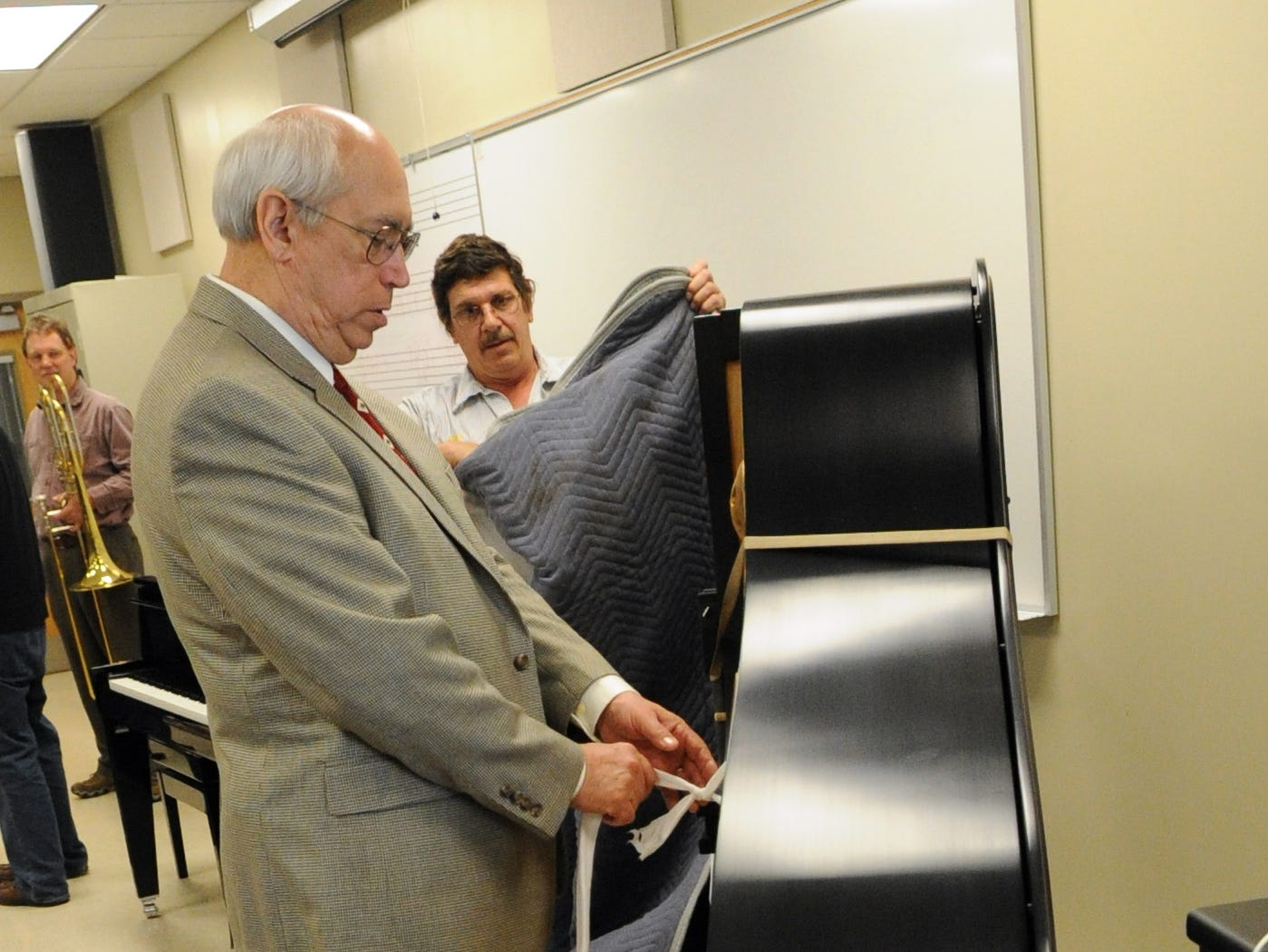 "American Piano Company owner Bill Metcalfe helps unwrap a Steinway piano after it was delivered at Pellissippi State Community College Thursday, May 5, 2011.  The college recently became an ""all-Steinway"" school boasting 13 of the maker's pianos."