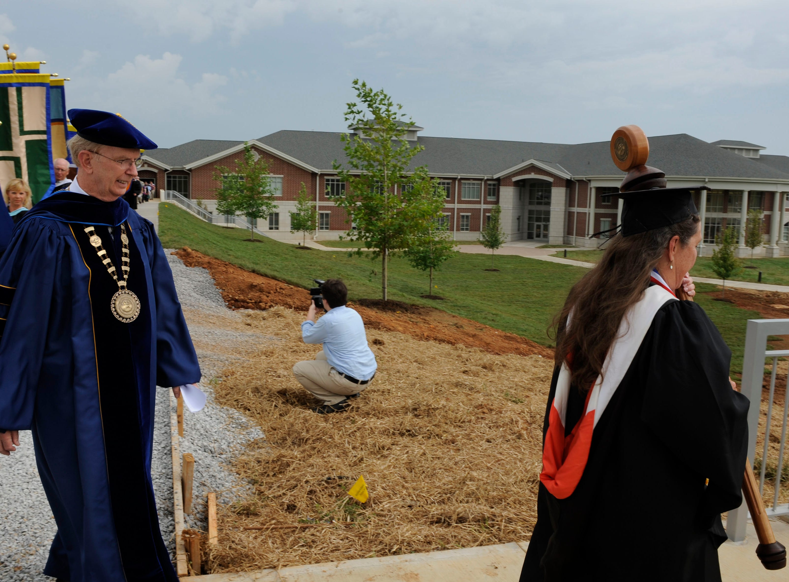 President Allen Edwards follows mace bearer Brenda Ammons during the opening ceremony for the new $22 million Pellissippi State Community College Blount County campus Wednesday, Aug. 18, 2010 in Friendsville.