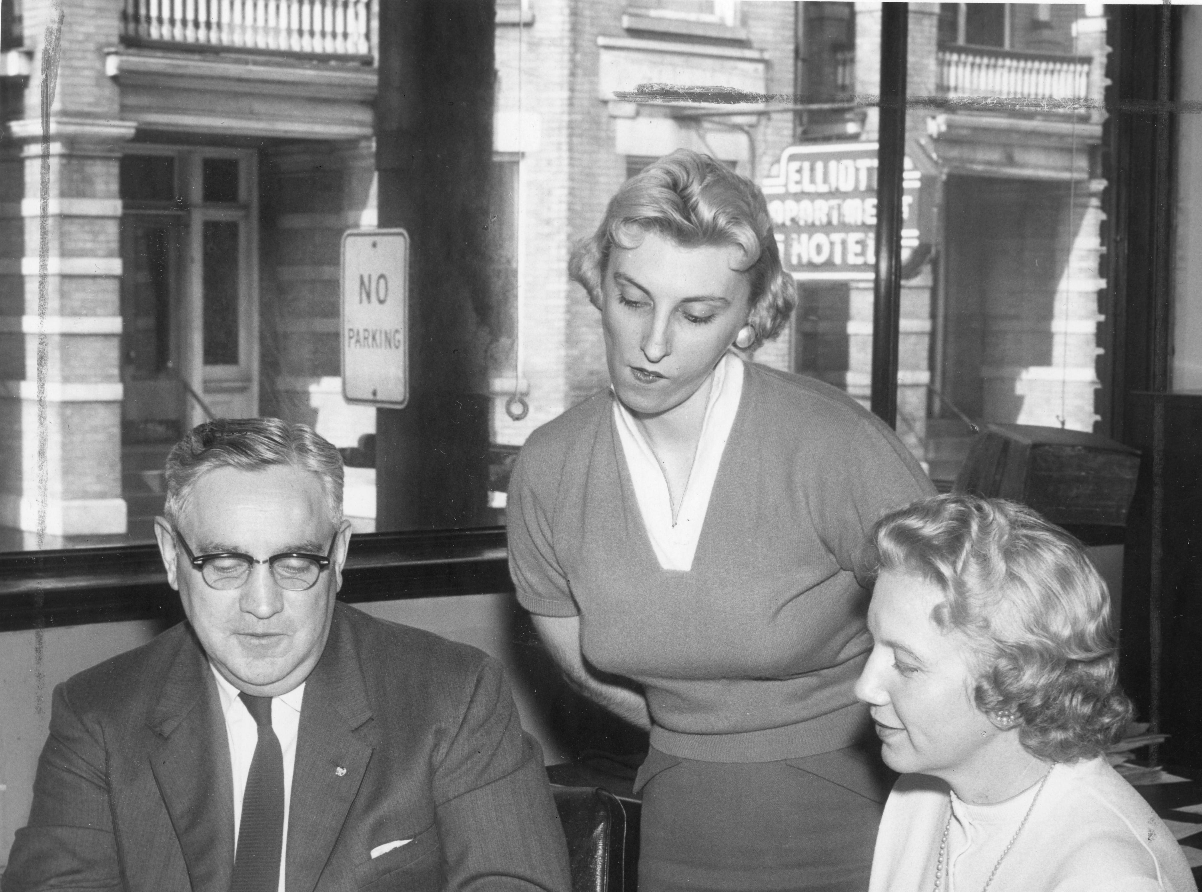 """""""Justin Routine"""" reads this March 1958 photo of Jim Howe, Miss Marlene Redding and Mrs. Genova Morris of the News Sentinel business office."""