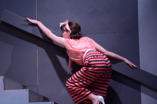 """Fianceé Carol Melkett (Rachael Allion) carefully makes her way up the stairs in complete darkness during """"Black Comedy,"""" produced at Pellissippi State Community College."""