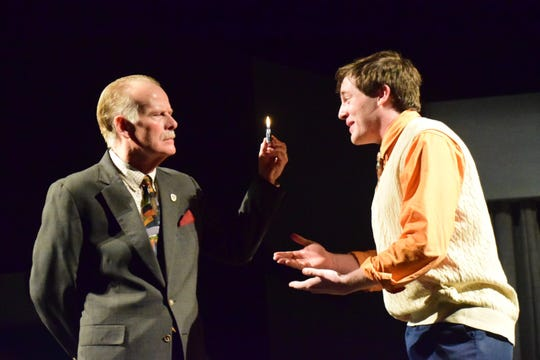 """Colonel Melkett, the fianceé's father (Peter Aylward), tries to light his way with a lighter while Brindsley Miller (Jackson Burnette) tries desperately to keep the shenanigans hidden during """"Black Comedy,"""" produced at Pellissippi State Community College."""