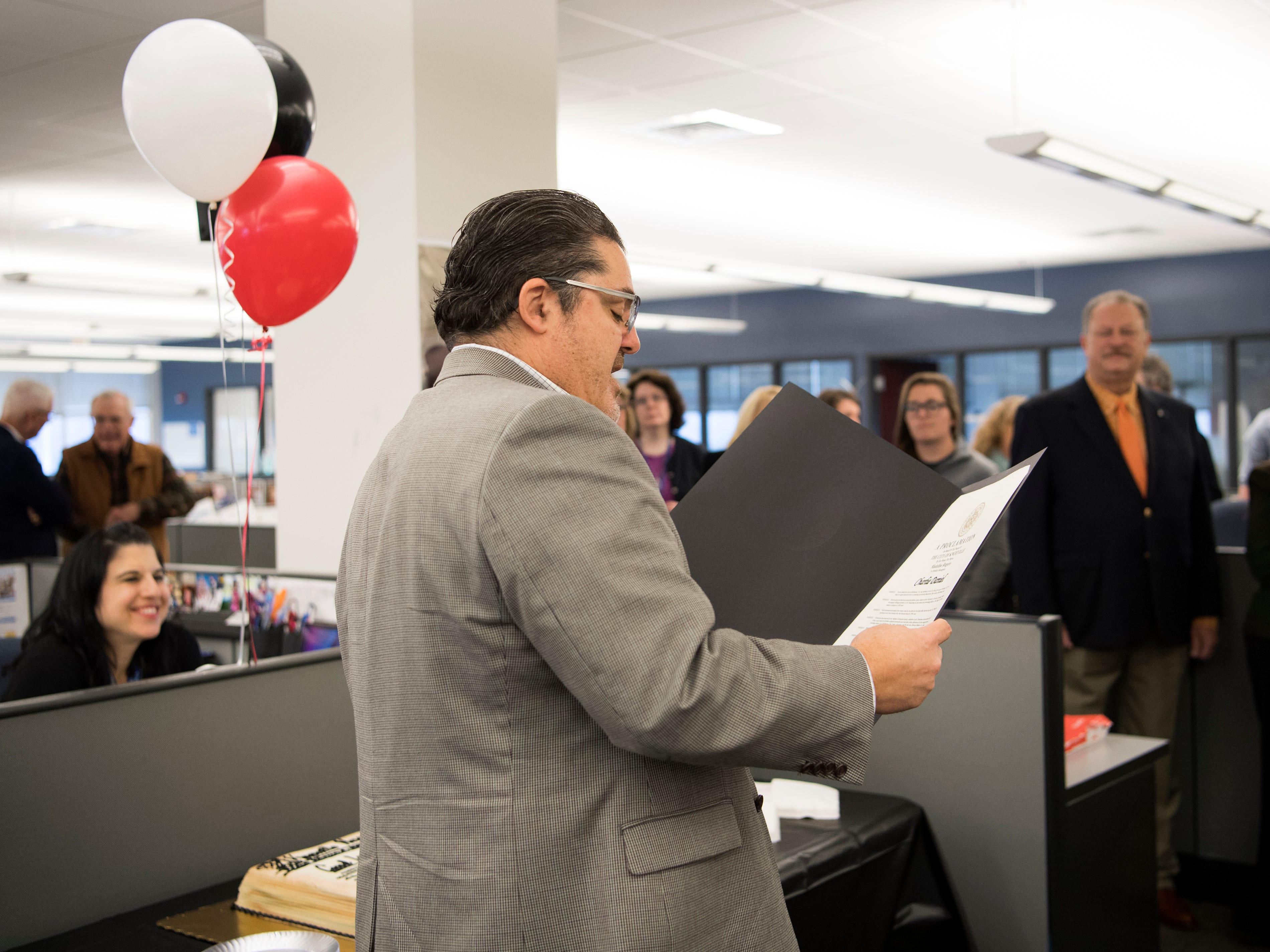 Michael Anastasi, Vice President/News for USA TODAY NETWORK Tennessee, speaks during a celebration for the retirements of executive editor Jack McElroy and cartoonist Charlie Daniel in the News Sentinel newsroom on Friday, February 1, 2019.