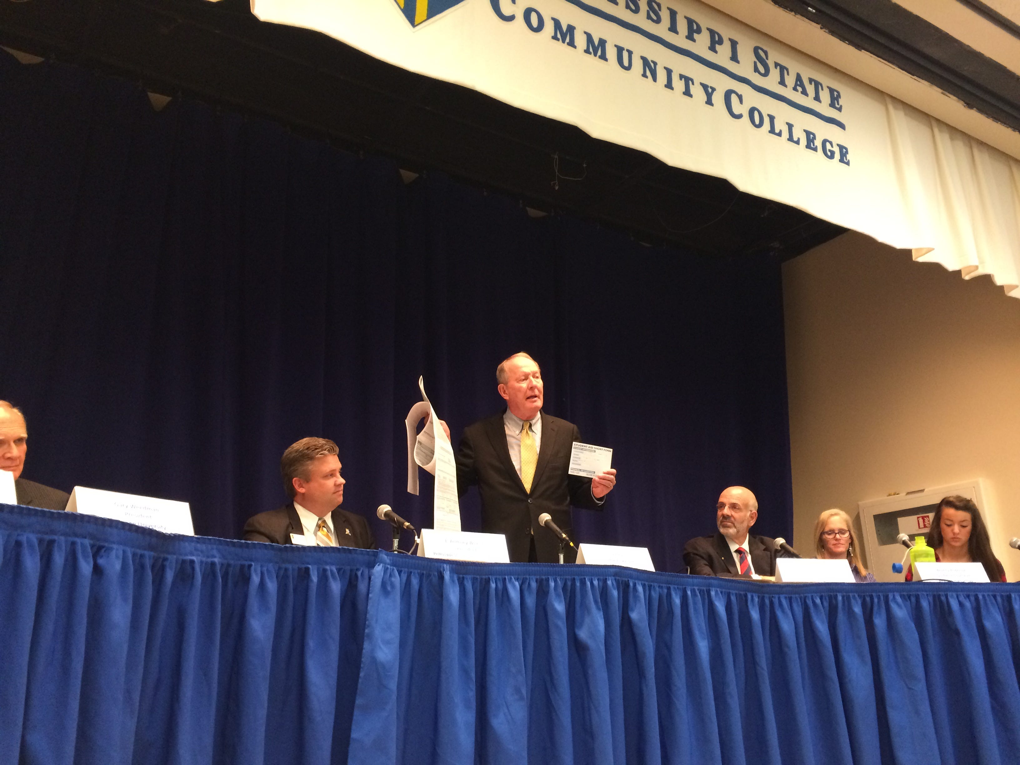 Sen. Lamar Alexander demonstrated the difference between the current free application for federal student aid, or FASFA, and his proposed shortened version during a roundtable discussion at Pellissippi State Community College Tuesday, Oct. 21.