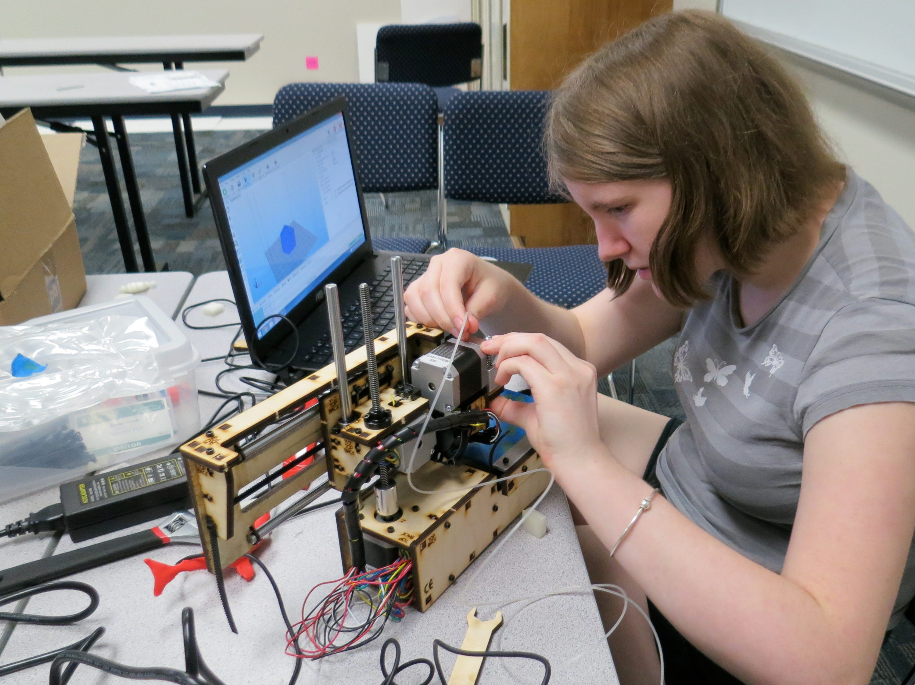 Theresa Keller from Karns Middle School gets ready to print a 3-D object during the Pellissippi State academic camp for young women.