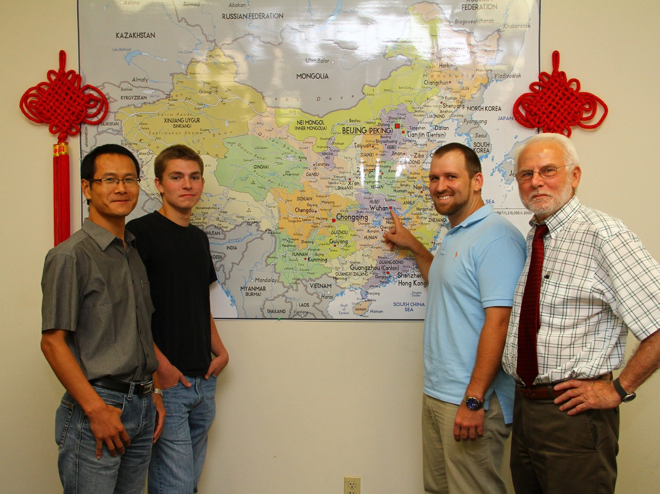Two Pellissippi State Community College students, Jack Little and Chris Summerville, received scholarships to study in China during the 2011-12 academic year. They will return to Knoxville in the spring. The experience gives them the chance to pursue their studies of Chinese language and culture while immersed in the country's daily life. From left, are, instructor Qiao Gui-qiang, Little, Summerville and Milton Grimes, now-retired executive director of Tennessee Consortium for International Studies