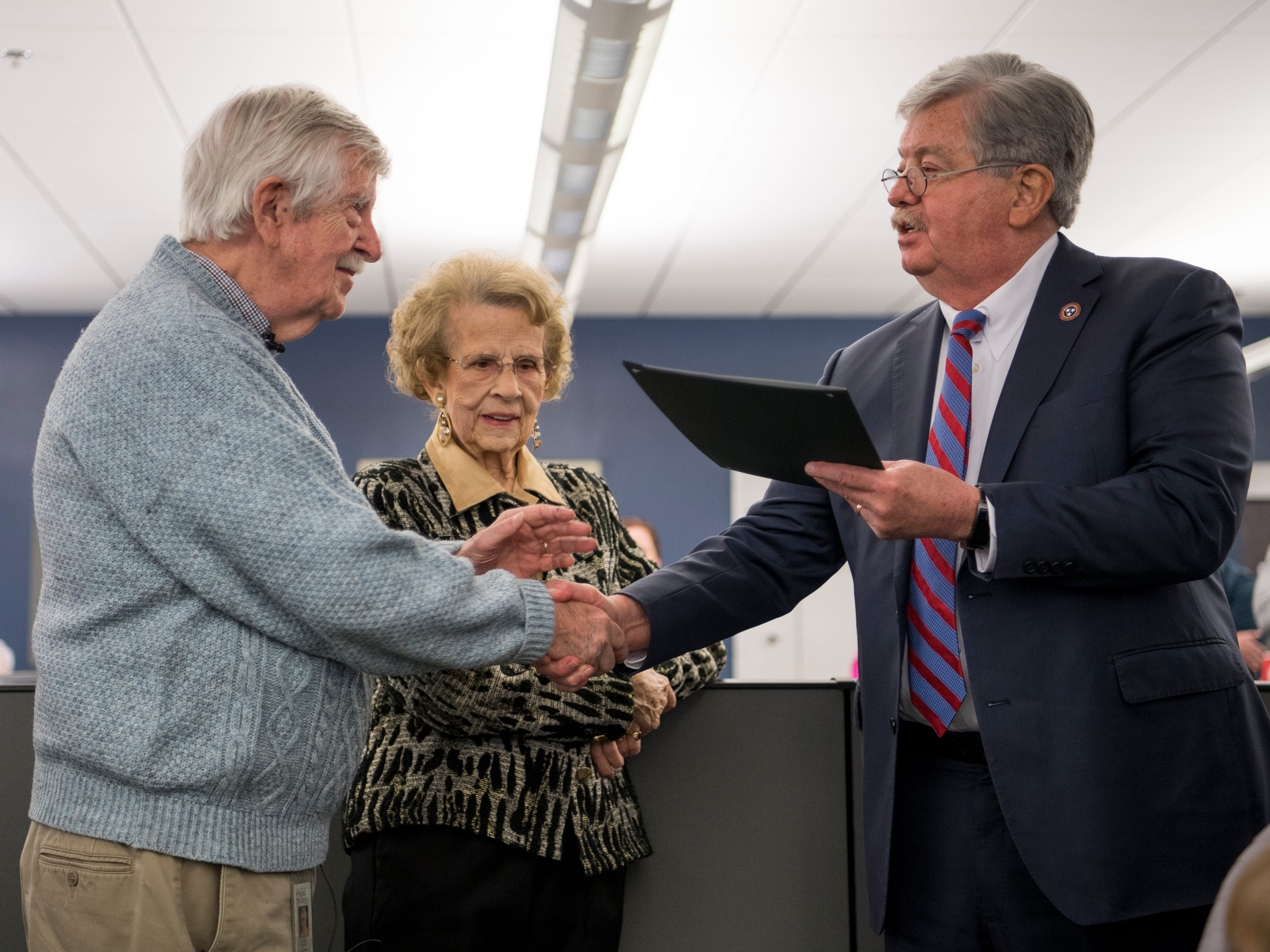 Tennessee Lt. Gov. Randy McNally, right, reads a proclamation for News Sentinel cartoonist Charlie Daniel, left, in the News Sentinel newsroom on Friday, February 1, 2019. The Knoxville News Sentinel celebrated the retirements of executive editor Jack McElroy and cartoonist Charlie Daniel.