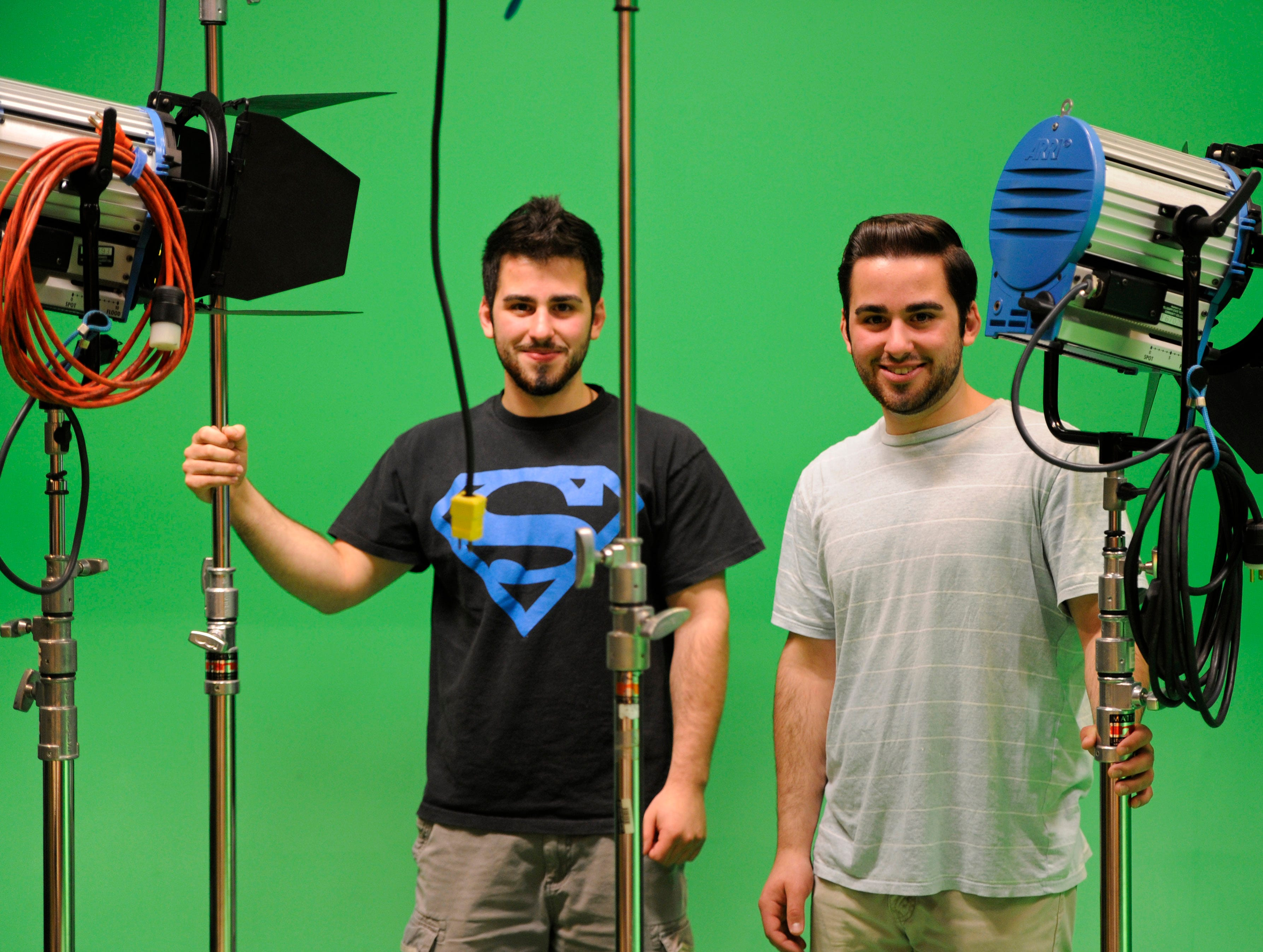 Nicky and Vinny Alfieri, from left, pose for a portrait in the Bagwell Center video studio at Pellissippi State Community College on Tuesday, April 21, 2015. The twin brothers are currently enrolled in the video production program at Pellissippi.