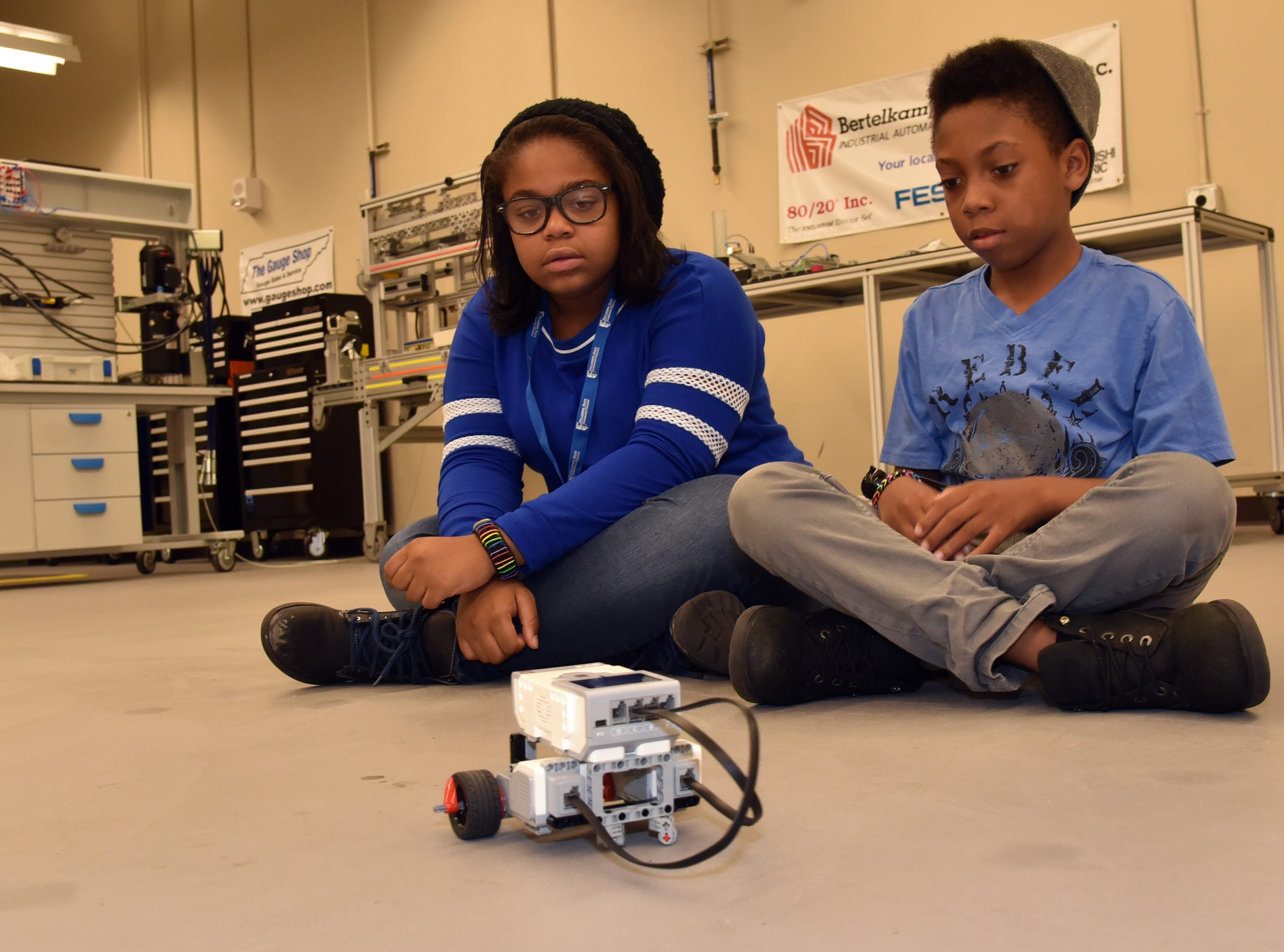 Madelyn Fox, left and Jamar Howell watch their robot maneuver during a Manufacturing and Coding Academy summer camp at the Strawberry Plains campus of Pellissippi State Thursday July 14, 2016. The students are from Project GRAD, the Boys & Girls Club, Great Schools Partnership and the Emerald Youth Foundation.