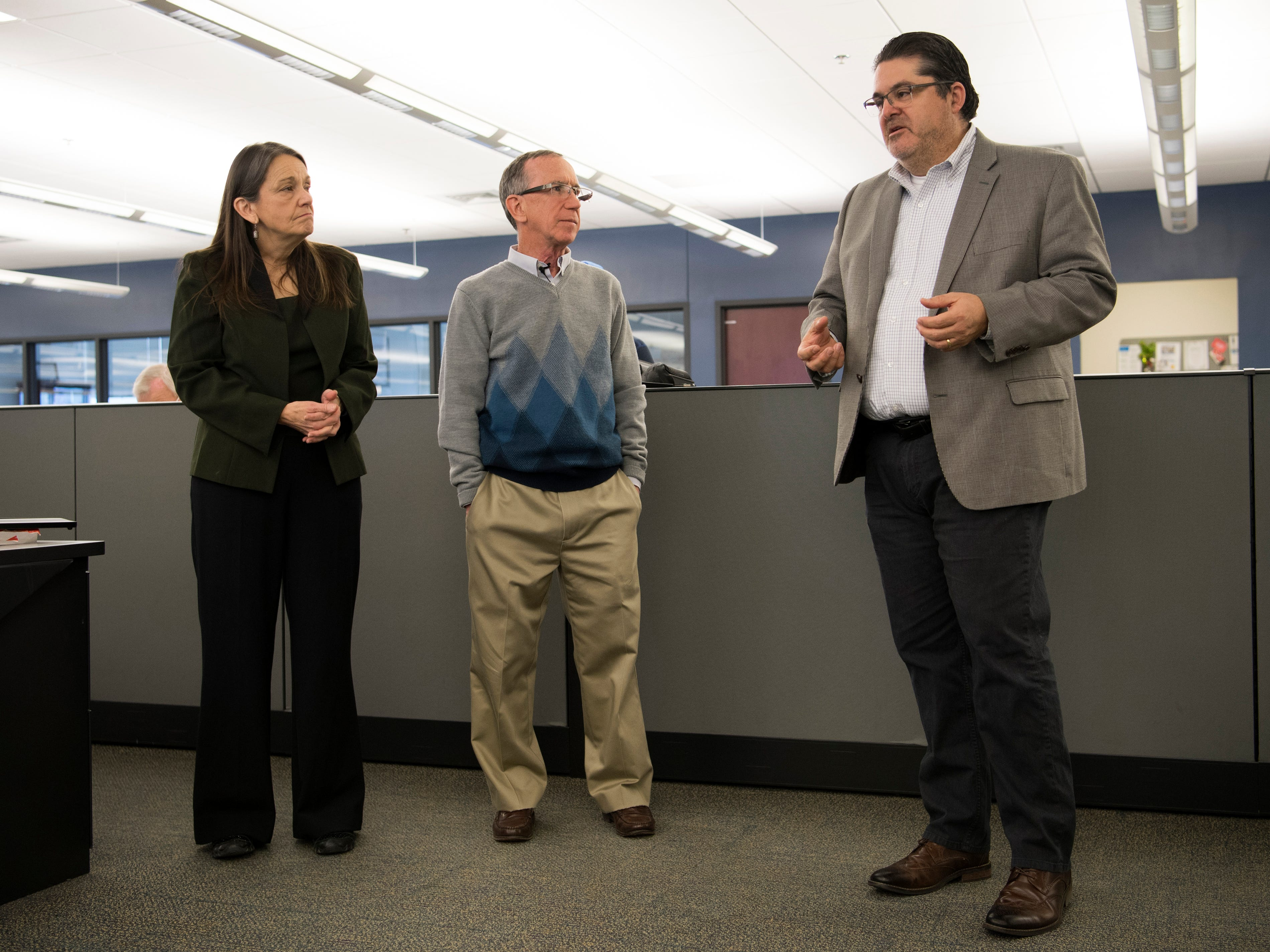 Michael Anastasi, Vice President/News for USA TODAY NETWORK Tennessee, at right, speaks during a celebration for the retirements of executive editor Jack McElroy and cartoonist Charlie Daniel in the News Sentinel newsroom on Friday, February 1, 2019.