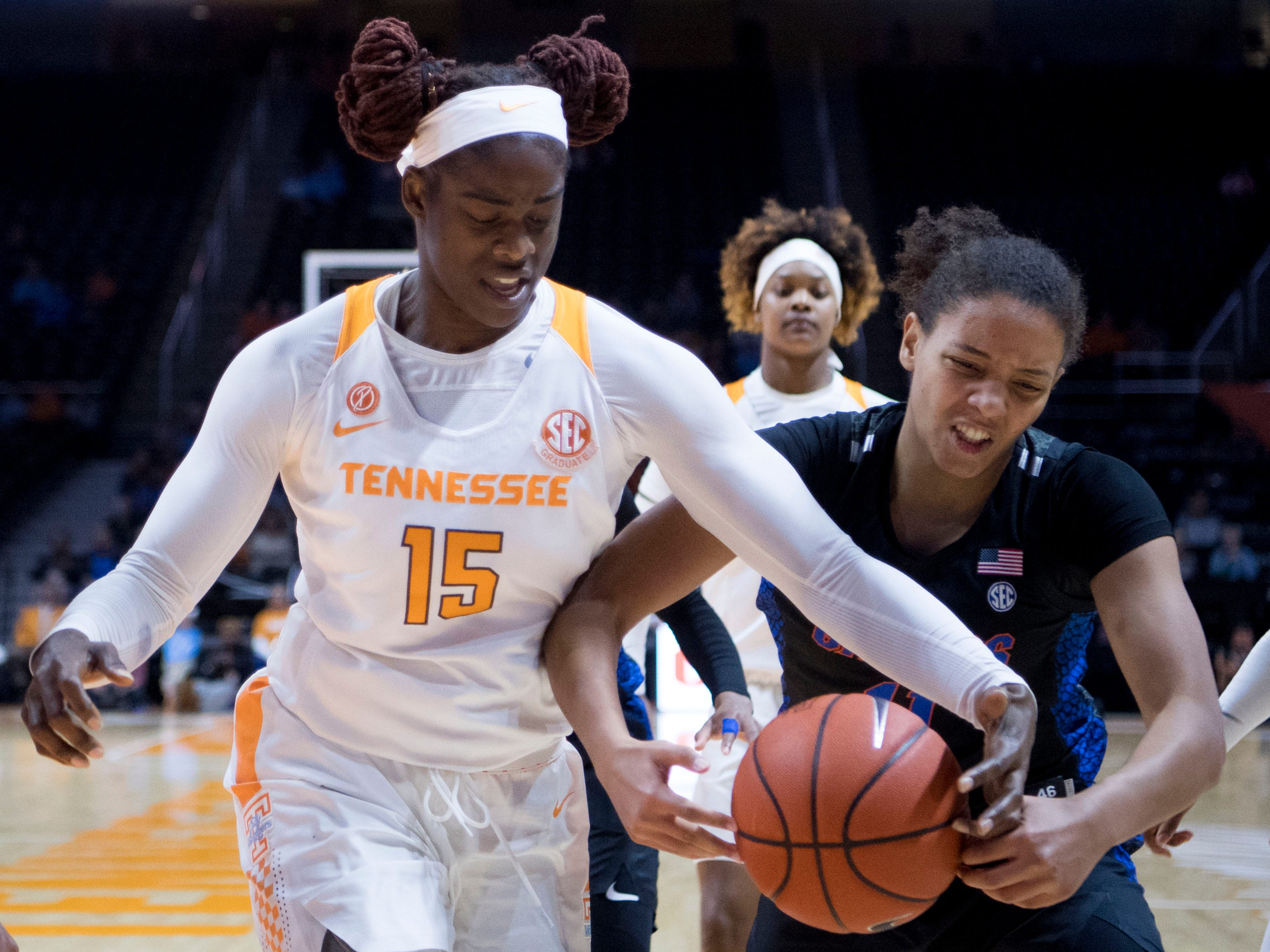 Tennessee's Cheridene Green (15) reaches for the rebound   with Florida's Emanuely de Oliveira (11) on Thursday, January 31, 2019.