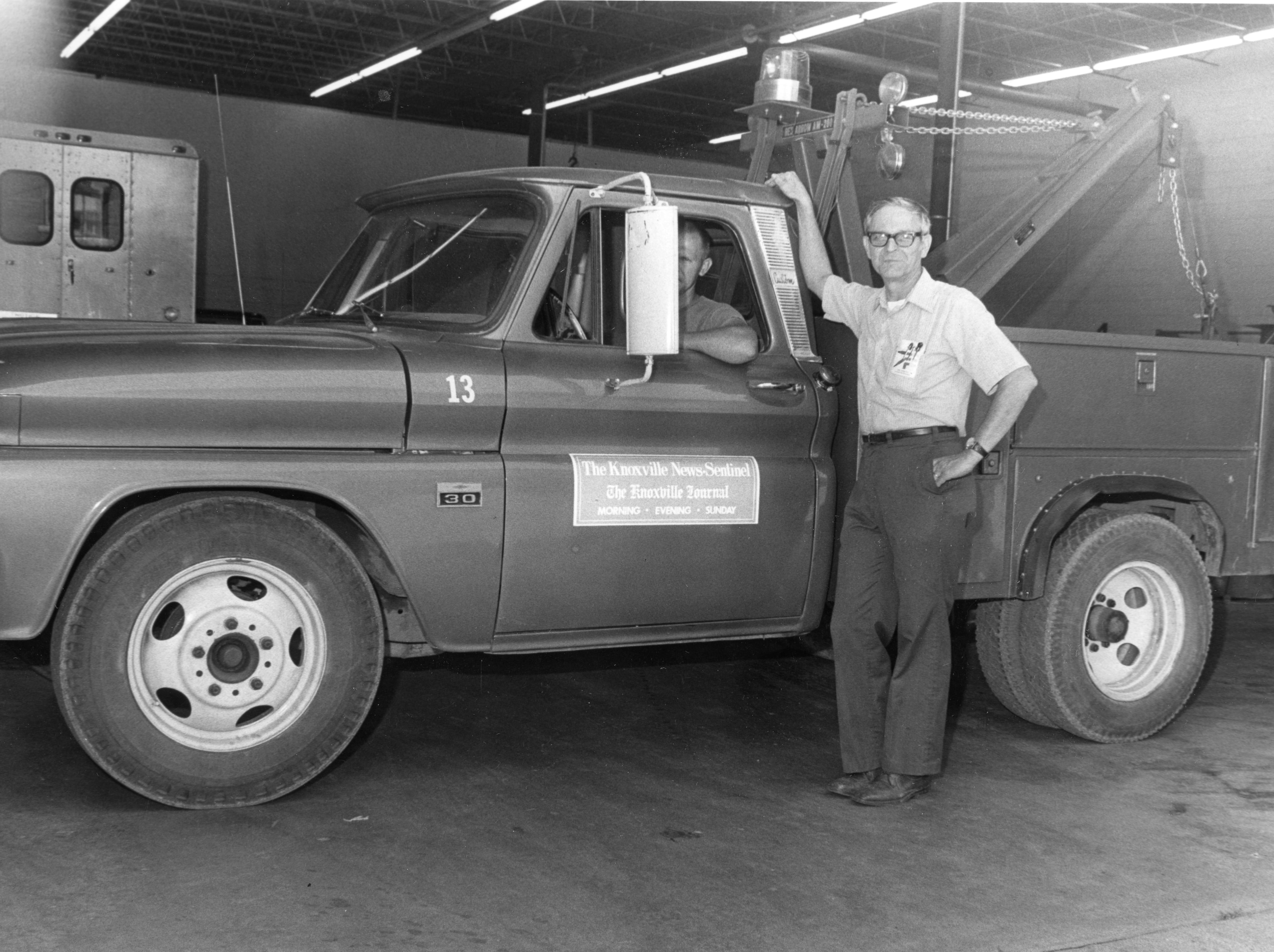 Roland Ball and R.B. Burnette, Garage Supervisor, of the News Sentinel.