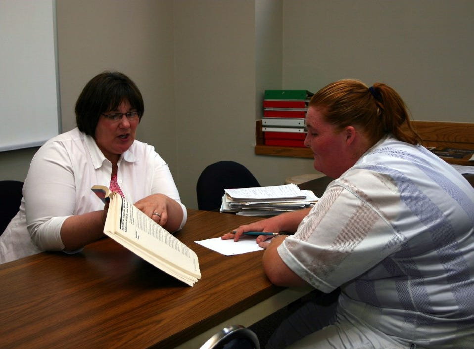 Pellissippi State Community College teacher Tamela Wheeler teaches a recovery client at Knox Area Rescue Ministry what she needs to know to earn her GED. Wheeler routinely comes to the ministry to tutor clients.